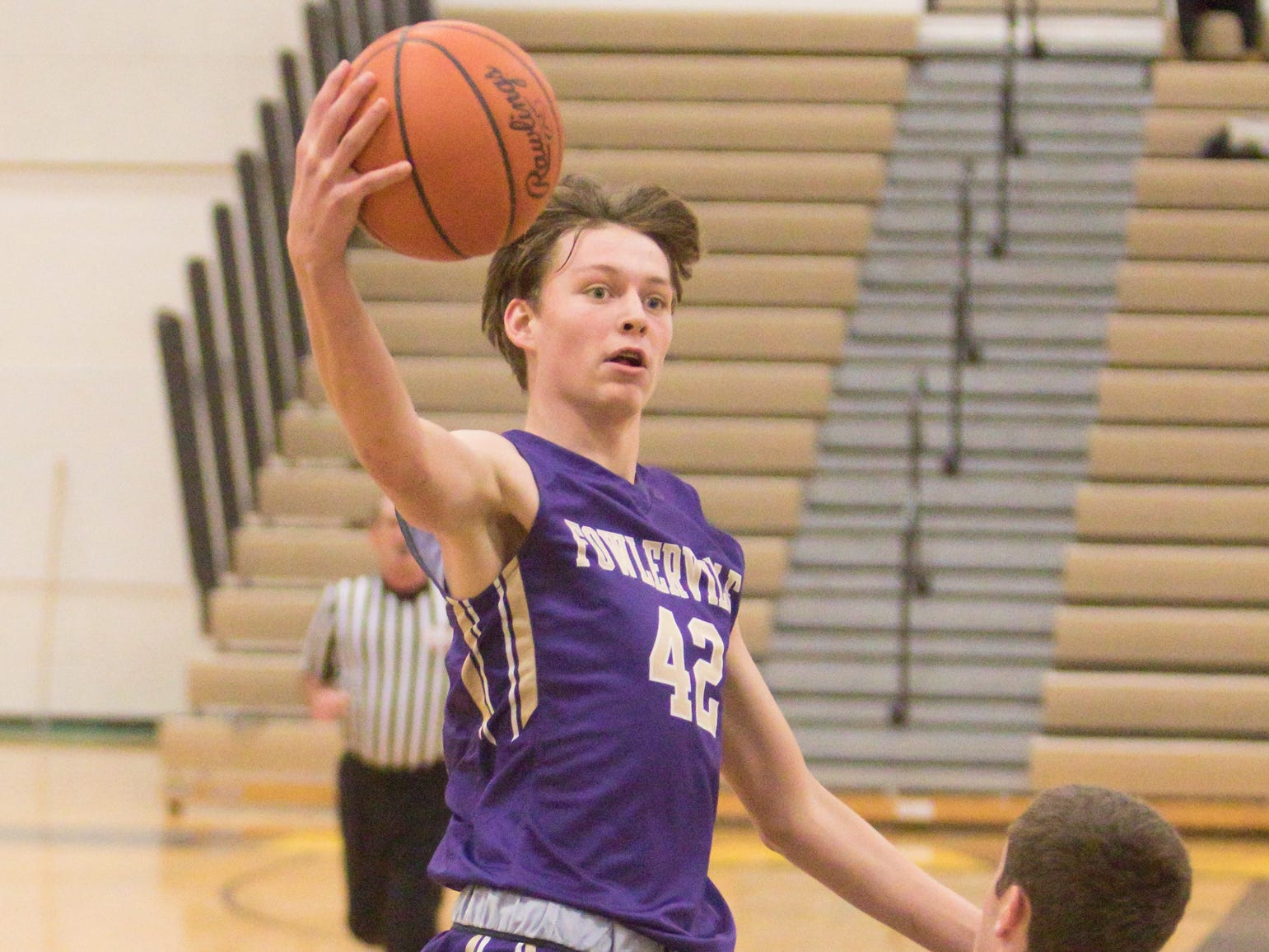 Fowlerville's Billy Hutchins shoots, getting fouled while making the shot in the third quarter of the game against Dexter Friday, Dec. 28, 2018.