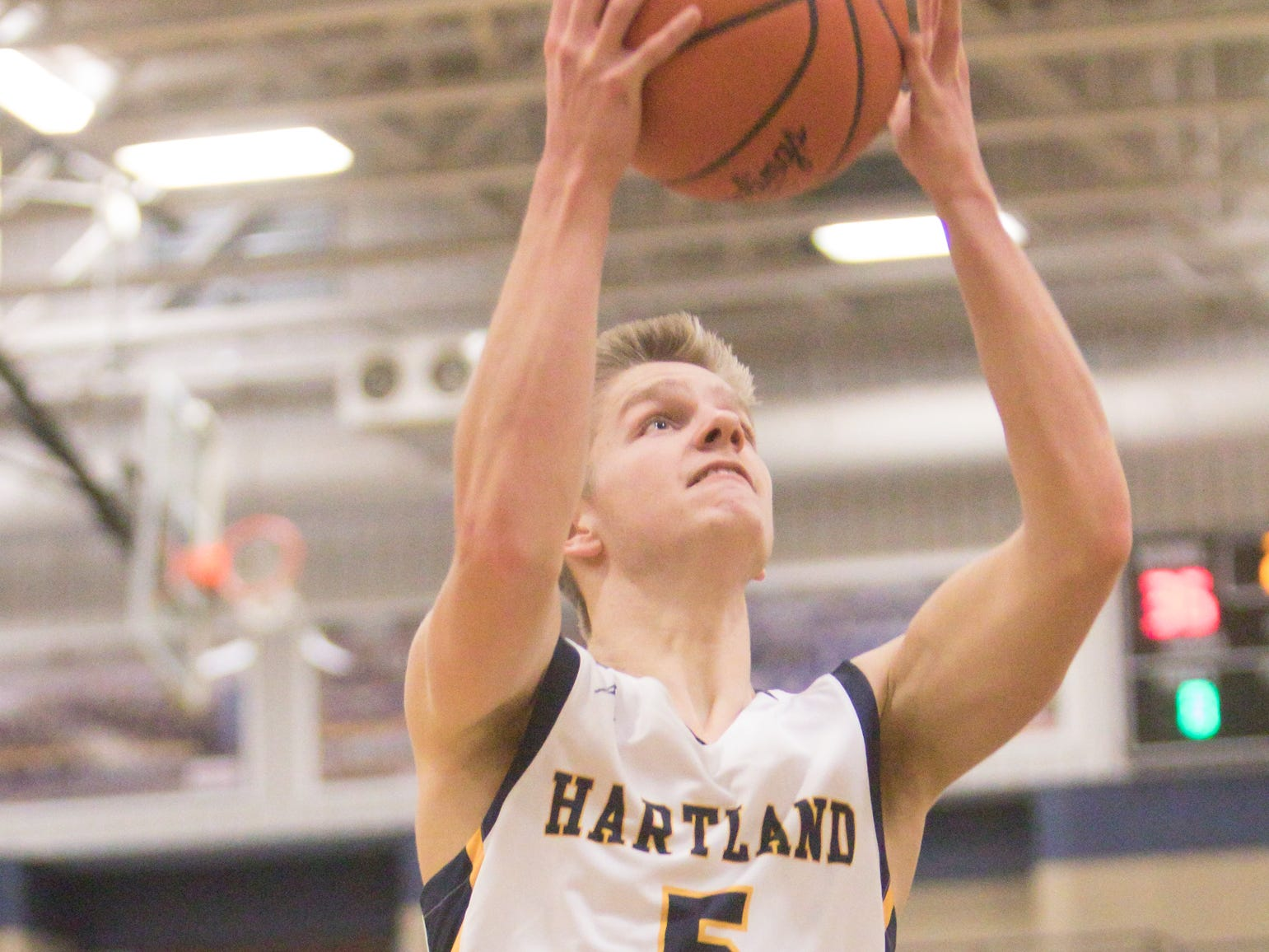Trevor Kulsavage of Hartland shoots in the game against South Lyon East Friday, Dec. 28, 2018.