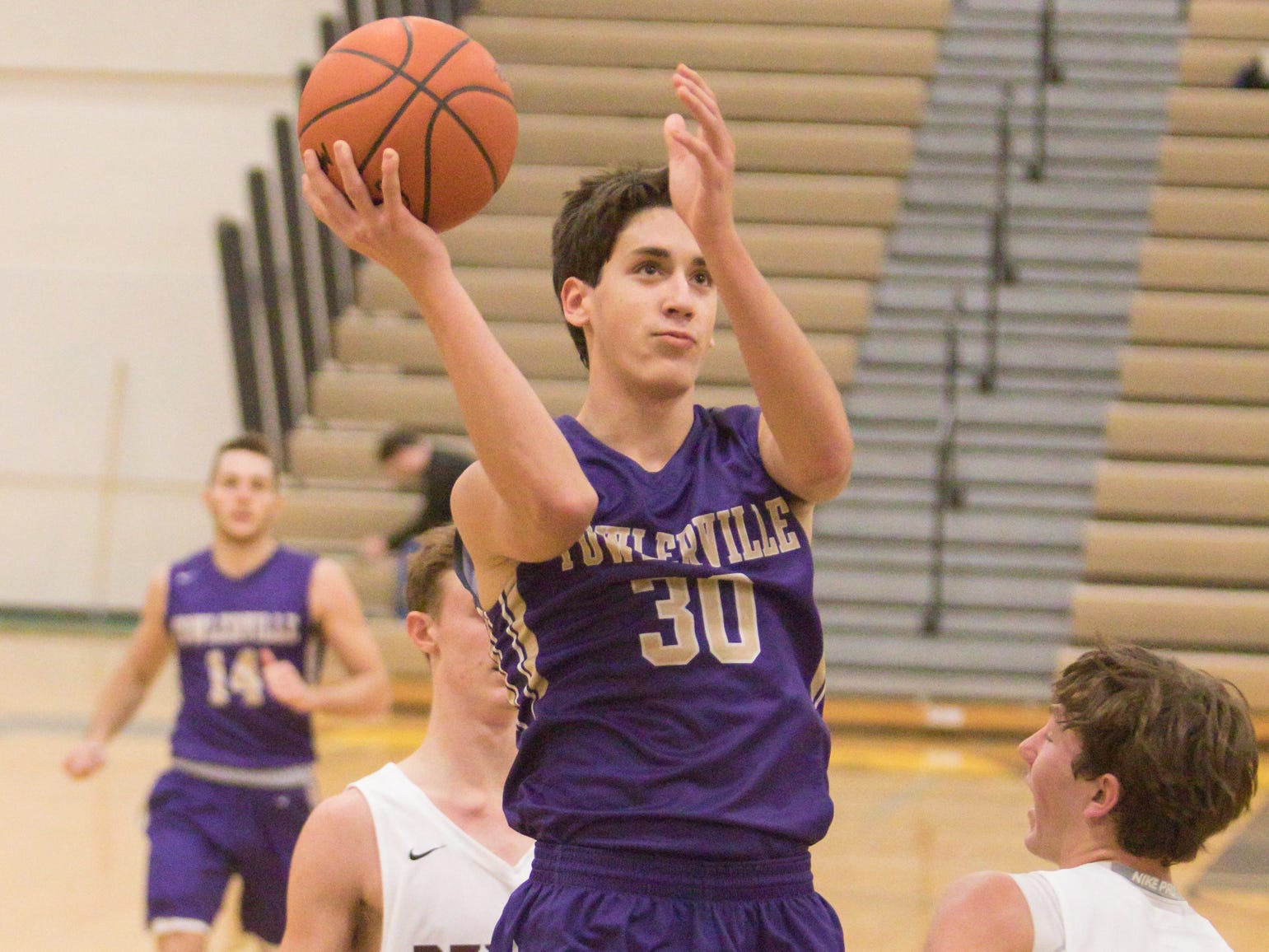 Josh Dufore of Fowlerville lines up his shot in the tournament game against Dexter Friday, Dec. 28, 2018.