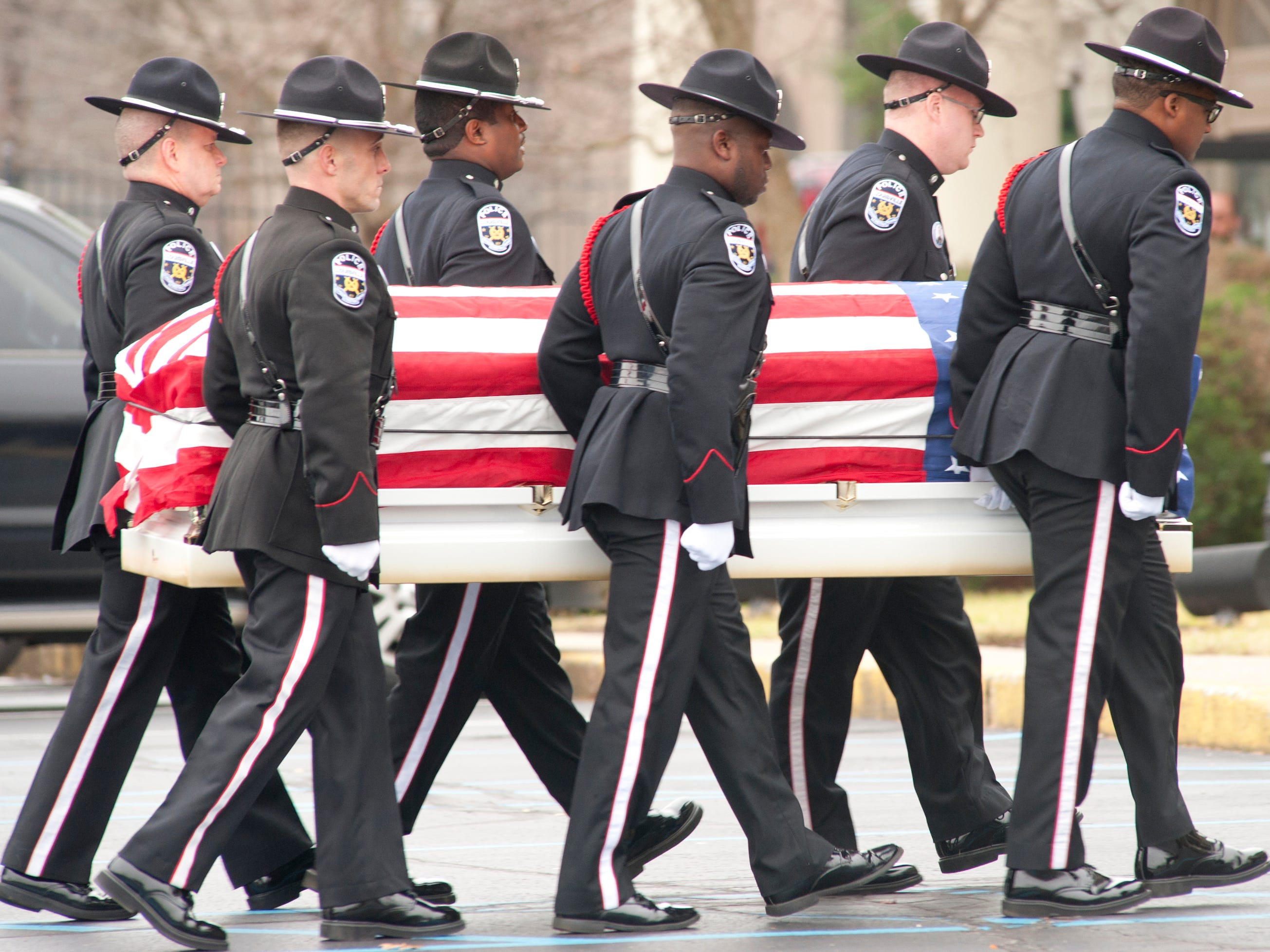 The LMPD Honor Guard slowly carries the casket of LMPD Detective Deidre Mengedoht into the Resthaven Funeral Home on Bardstown Road.