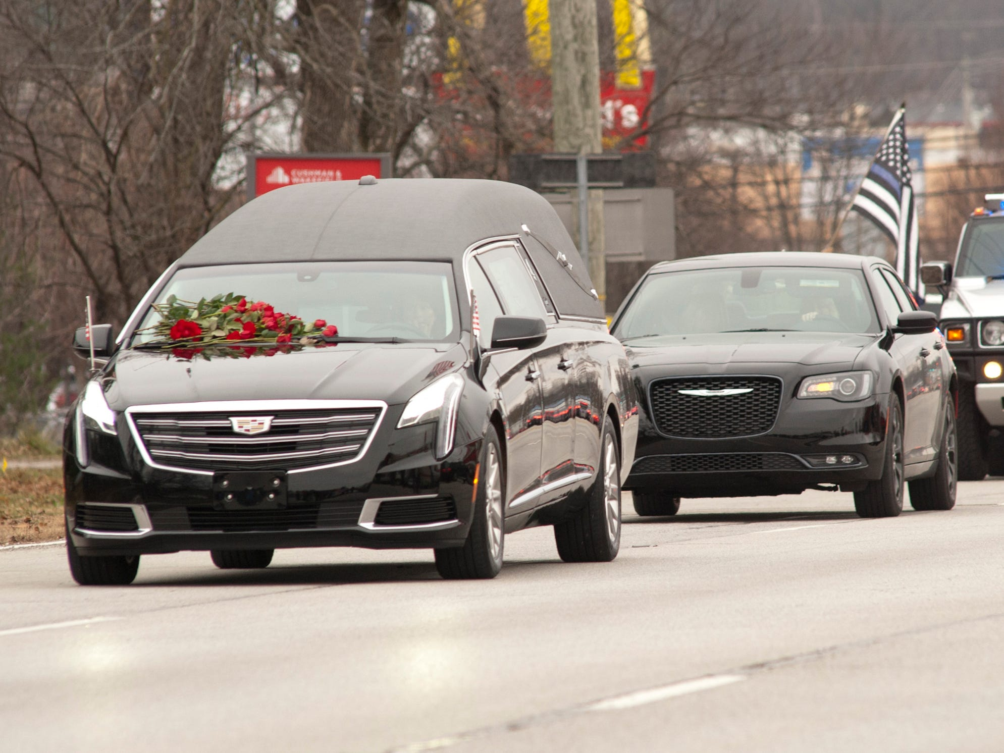 The procession of LMPD Detective Deidre Mengedoht from S. 3rd Street to the Resthaven Funeral Home on Bardstown Road.
