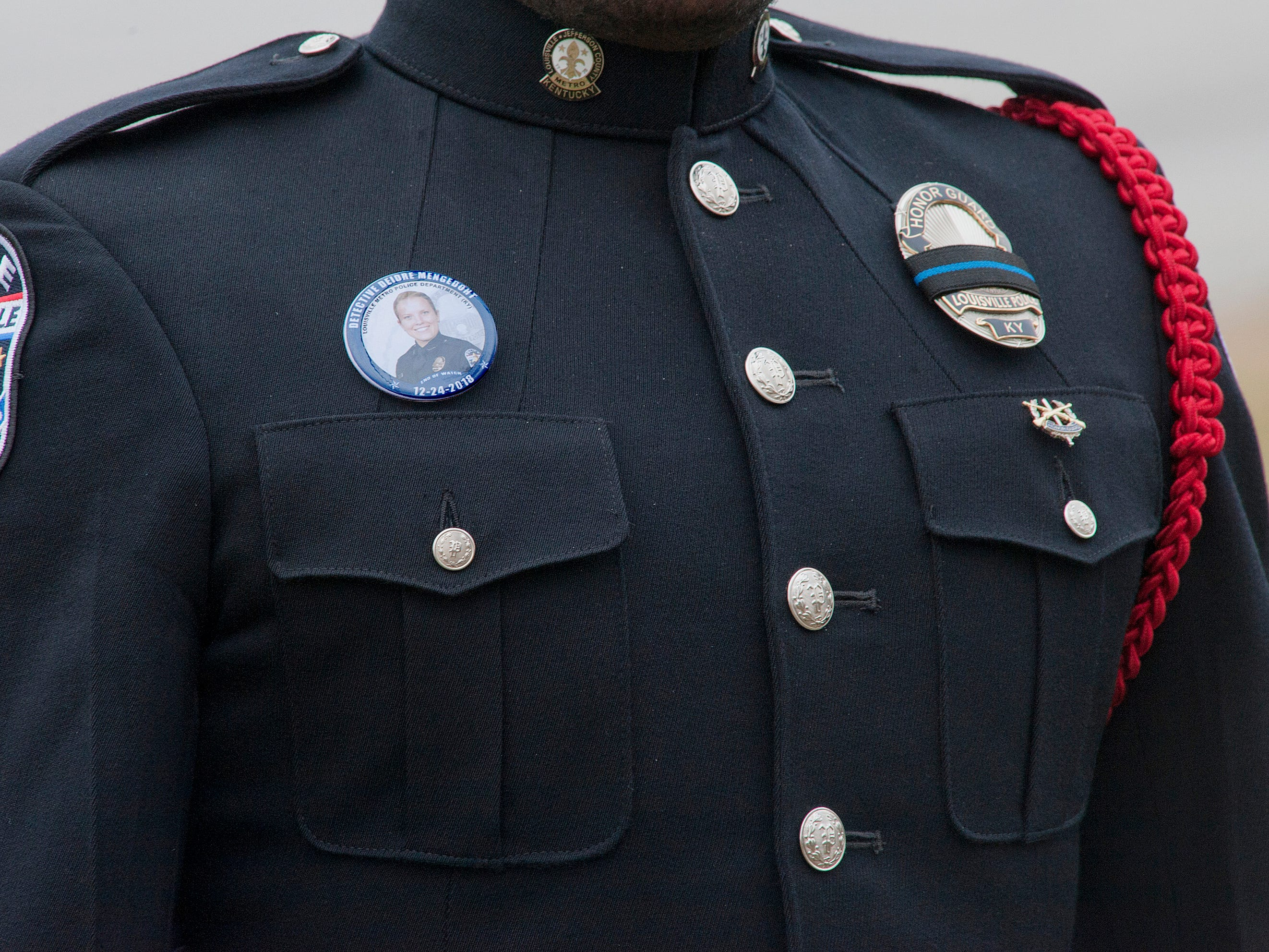 Detail of the LMPD honor guard for Detective Deidre Mengedoht. Her photo is on a button worn by the guard.