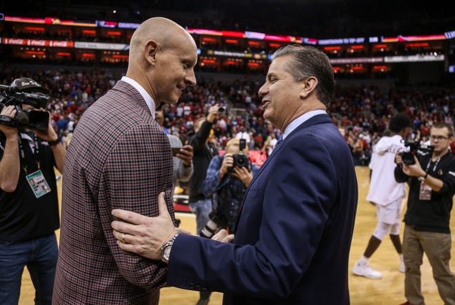 Kentucky's John Calipari and Louisville's Chris Mack exchanged greetings before the game Saturday afternoon at the KFC Yum! Center in downtown Louisville. Dec. 29, 2018