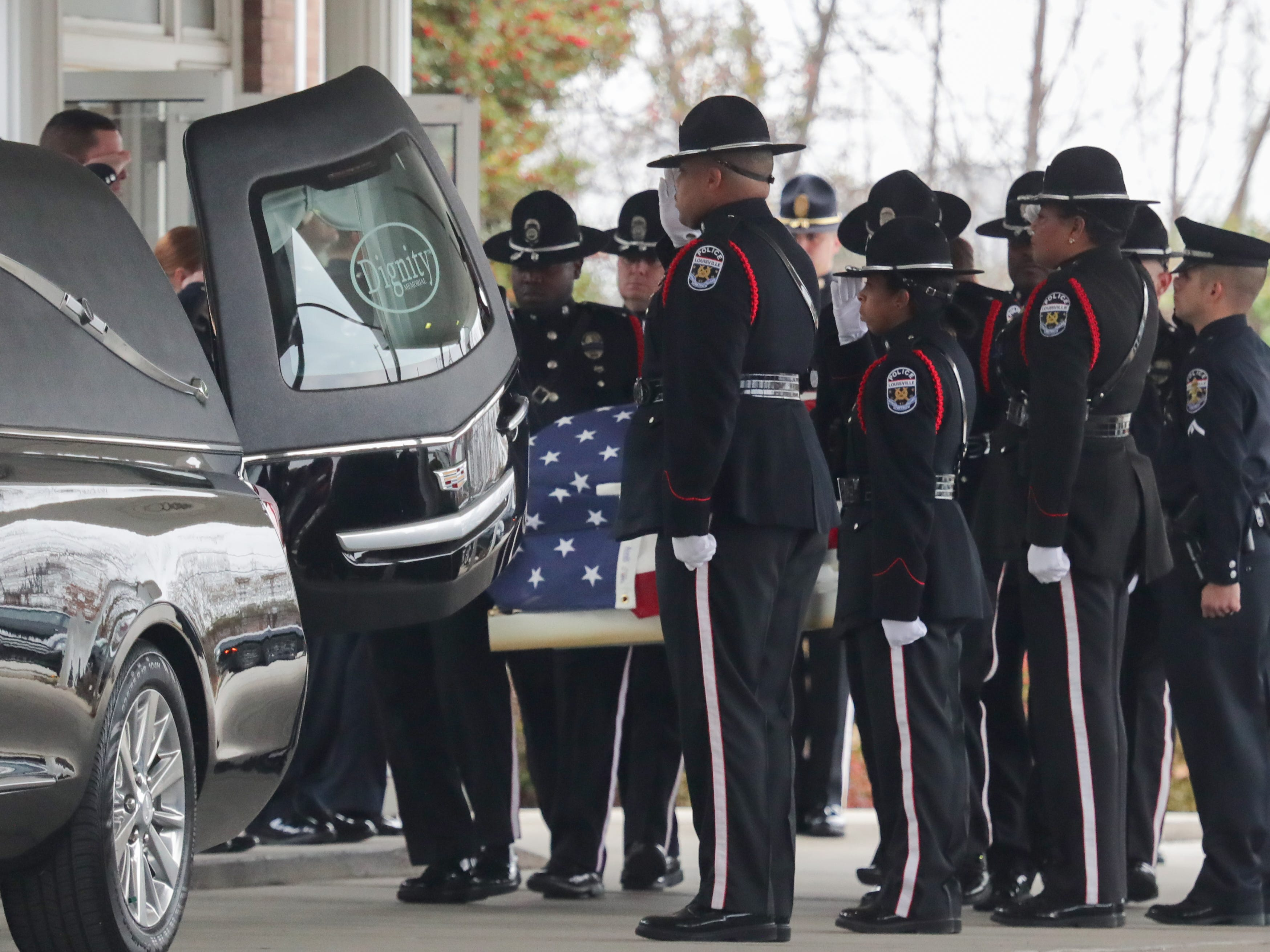 Louisville Metro Police carry the flag-trapped coffin of Detective Deidre Mengedoht to the hearse Saturday morning at O.D. White Funeral home on South Third Street before her last tour through the neighborhoods she patrolled as well as the Second District headquarters. Dec. 29, 2018