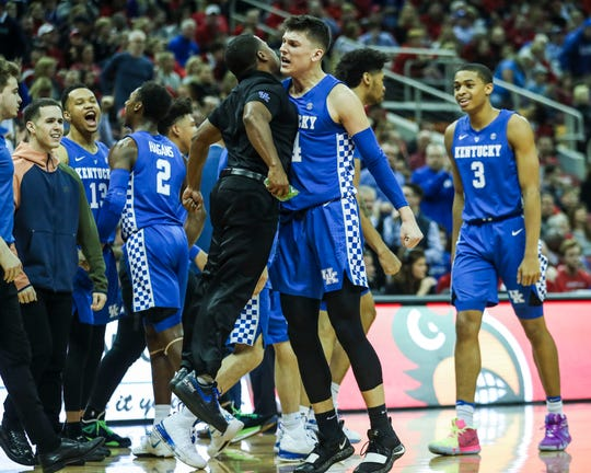Kentucky's Tyler Herro celebrates as the Wildcats pulled away from Louisville in Battle of the Bluegrass Saturday afternoon at the KFC Yum! Center in downtown Louisville. Herro led the team with 24 points. Dec. 29, 2018