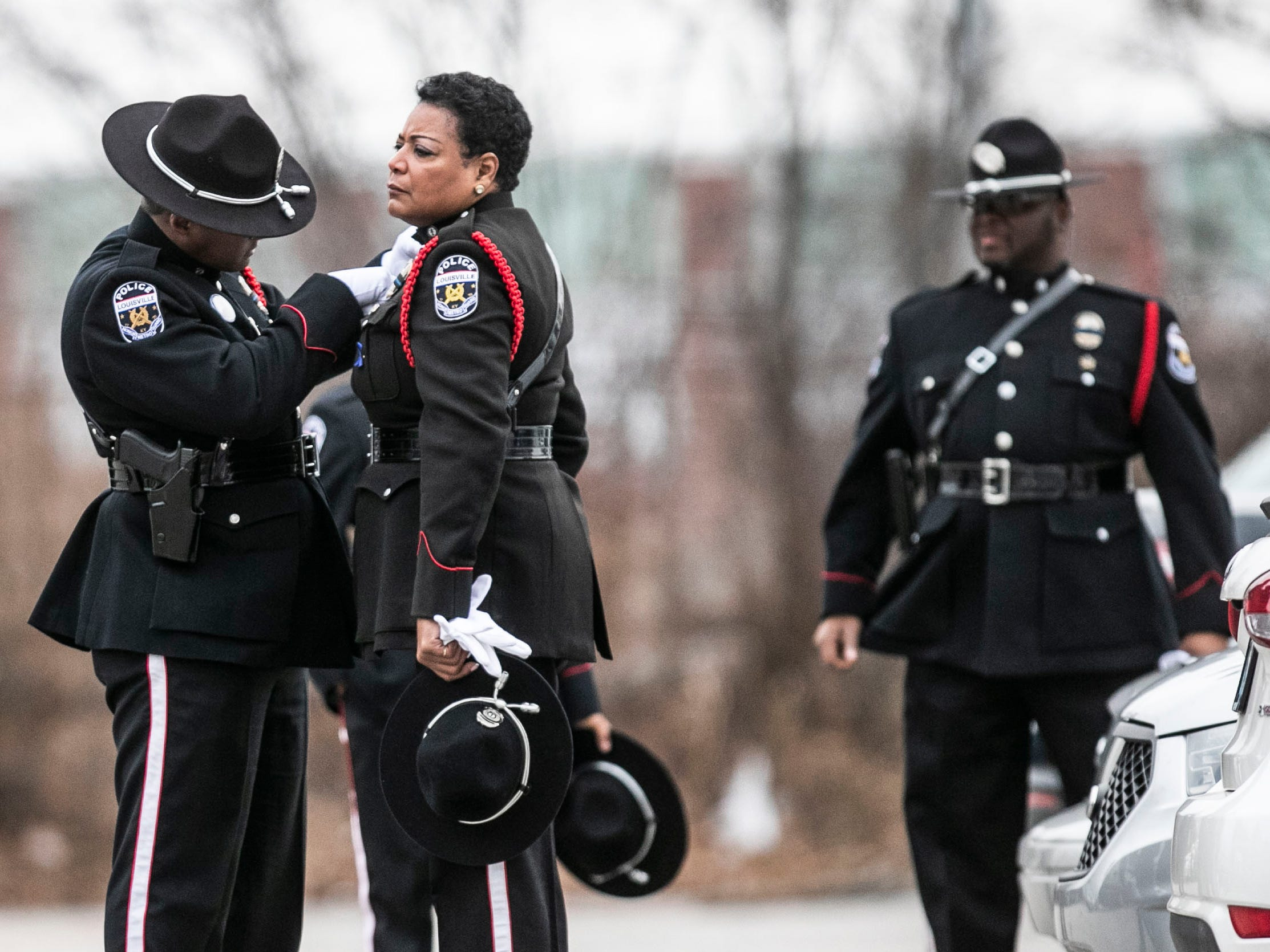 LMPD officers prepare before the procession for LMPD Detective Deidre Mengedoht Saturday morning. Dec. 29, 2018
