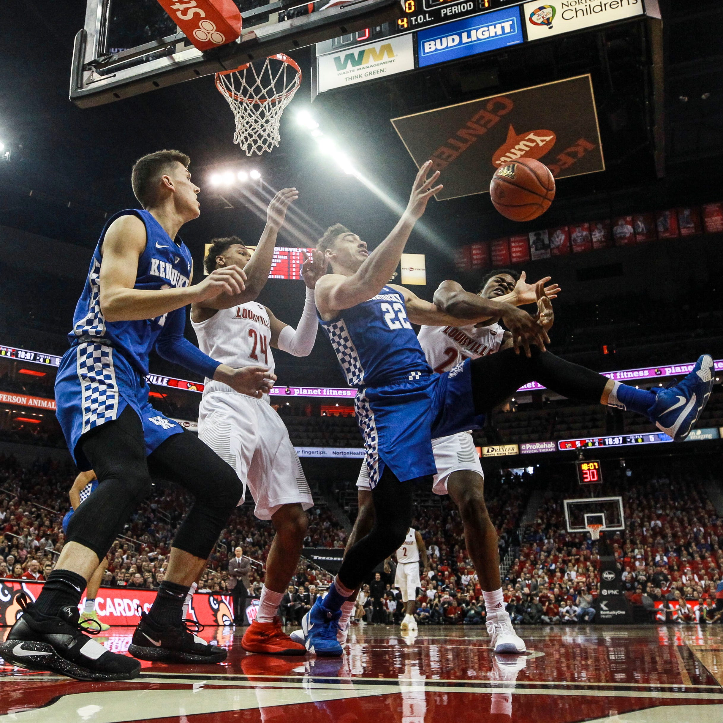 Kentucky's Reid Travis tries to grab a loose ball as Louisville's Steven Enoch pressures during the game against Louisville Saturday afternoon at the KFC Yum! Center in downtown Louisville. Dec. 29, 2018