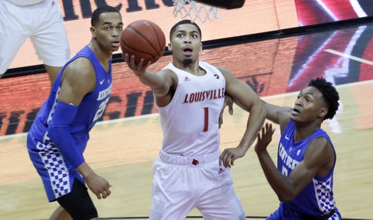 Louisville's Christen Cunningham gets past Kentucky's Immanuel Quickly for the layup.