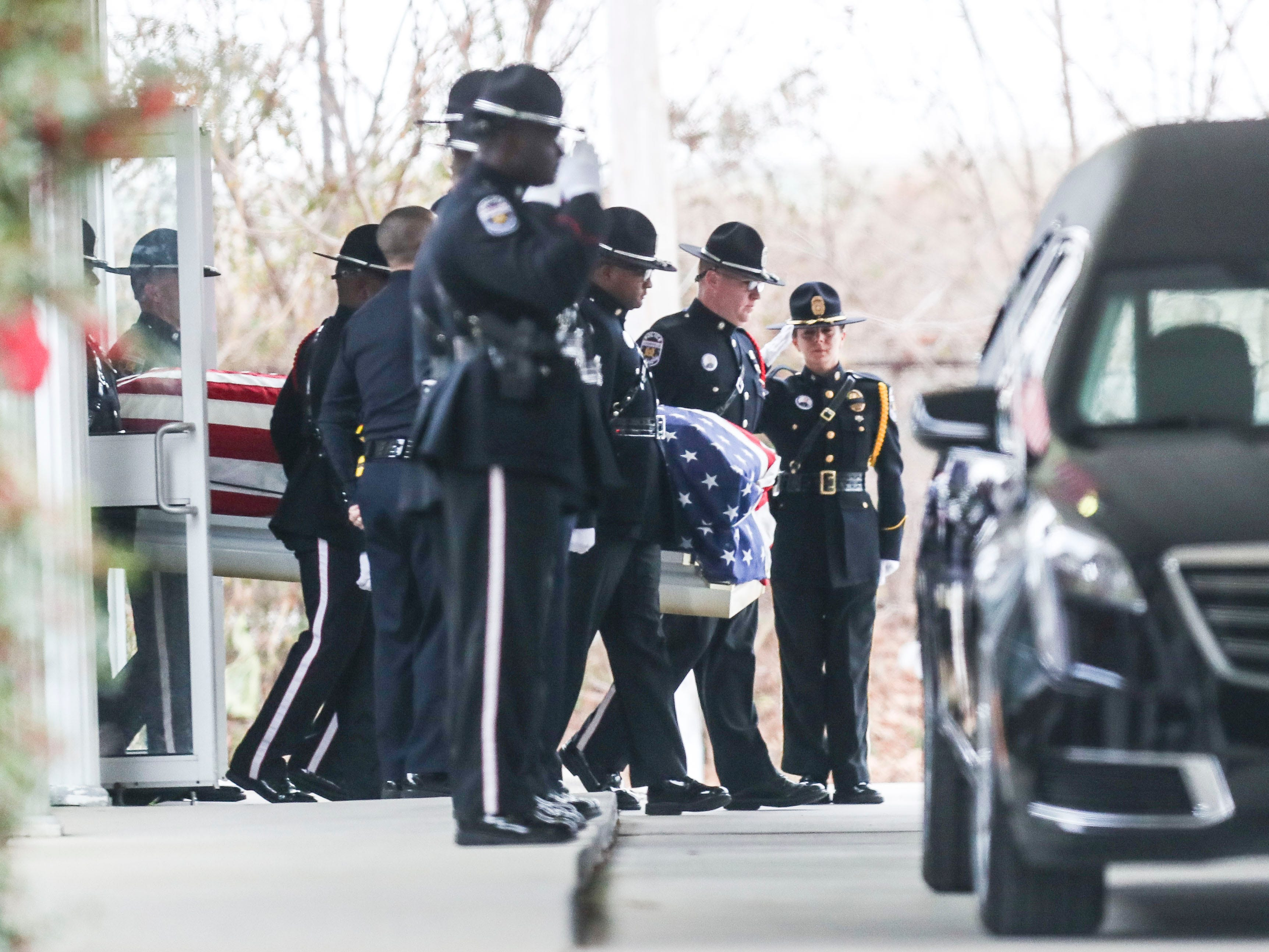 Louisville Metro Police carry the flag-draped coffin of Detective Deidre Mengedoht to the hearse Saturday morning at O.D. White Funeral home on South Third Street before her last tour through the neighborhoods she patrolled as well as the Second District headquarters. Dec. 29, 2018
