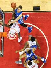 Kentucky's Reid Travis tries to score  against Louisville's Steven Enoch at the KFC Yum! Center in downtown Louisville. Travis finished with nine points. Dec. 29, 2018