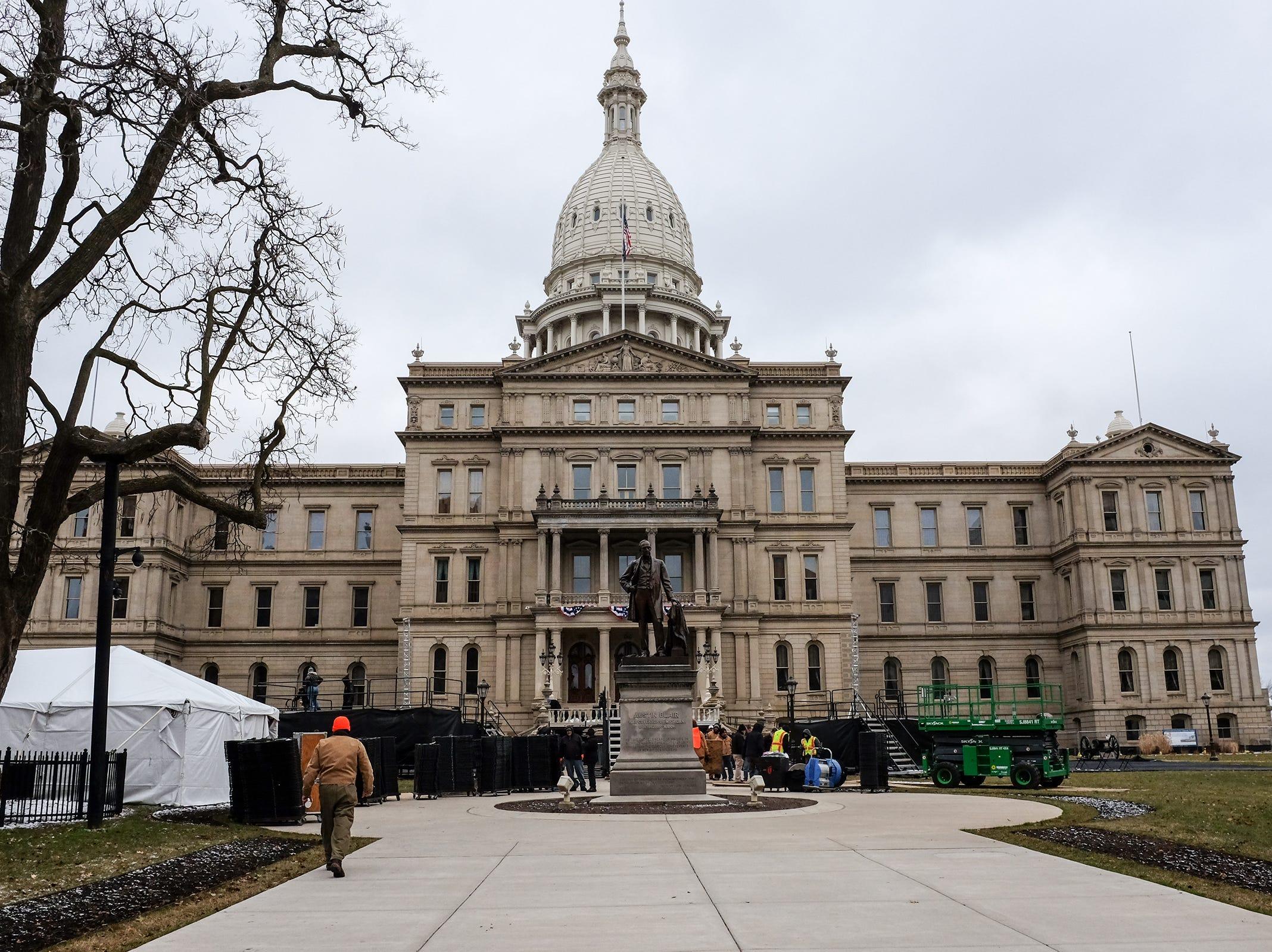 Workmen continue preparing for the Governor's inauguration at the state Capitol Saturday, Dec. 29, 2018.