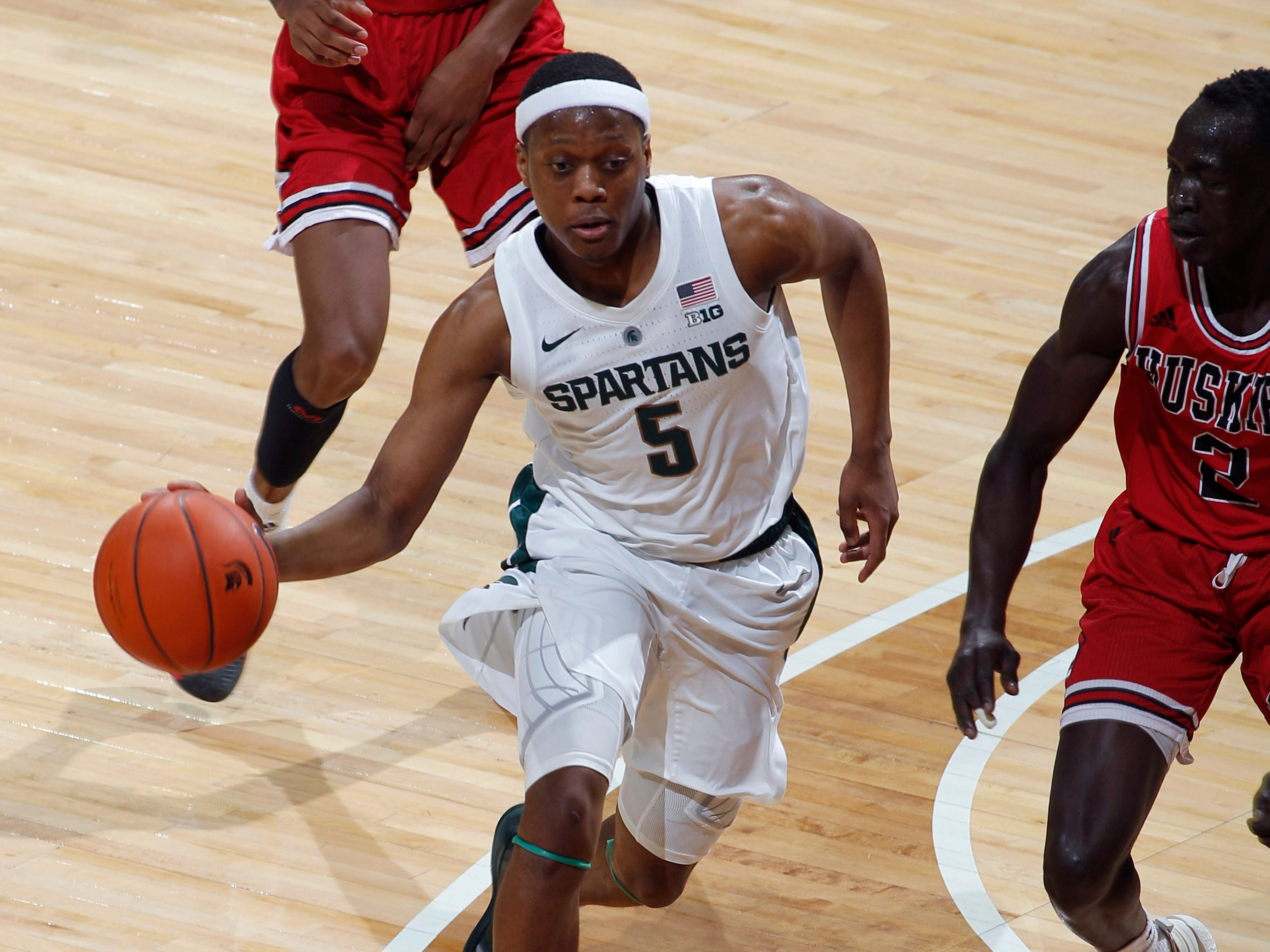 Michigan State's Cassius Winston (5) drives against Northern Illinois' Gairges Daow, Saturday, Dec. 29, 2018, in East Lansing, Mich.