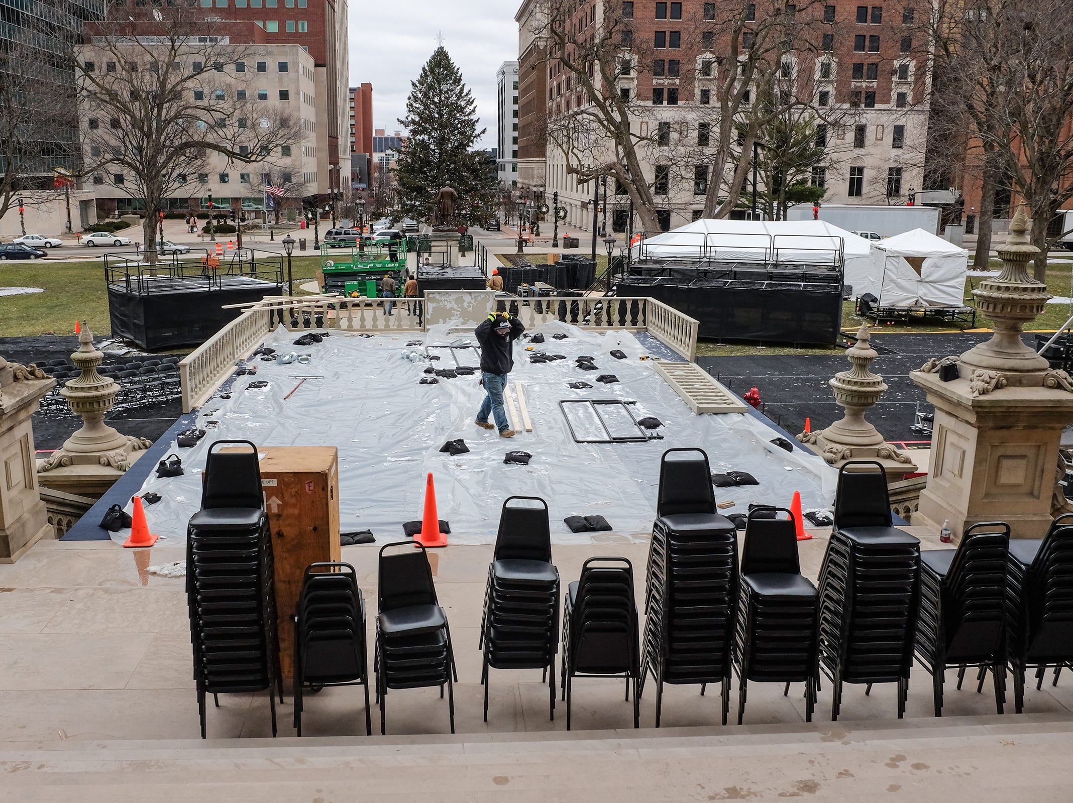 Things are starting to take shape for the inauguration of Michigan's new Governor, Gretchen Whitmer, as workmen begin building the stage over the steps of the state Capitol Saturday, Dec. 29, 2018.