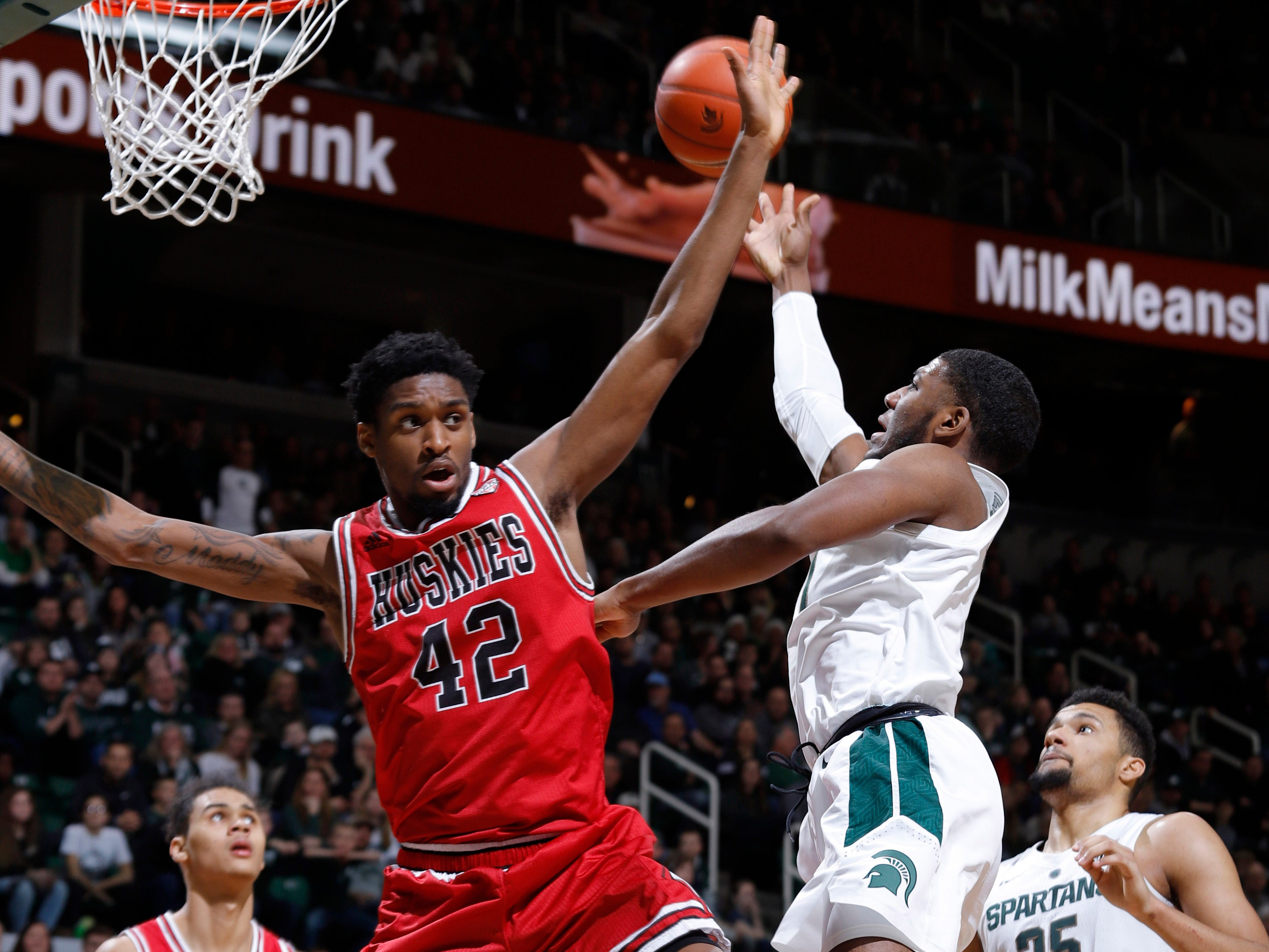Michigan State's Aaron Henry, right, goes up for a shot against Northern Illinois' Levi Bradley (42), Saturday, Dec. 29, 2018, in East Lansing, Mich.