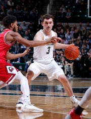Michigan State's Foster Loyer (3) runs the point against Northern Illinois' Zaire Mateen, Saturday, Dec. 29, 2018, in East Lansing, Mich.