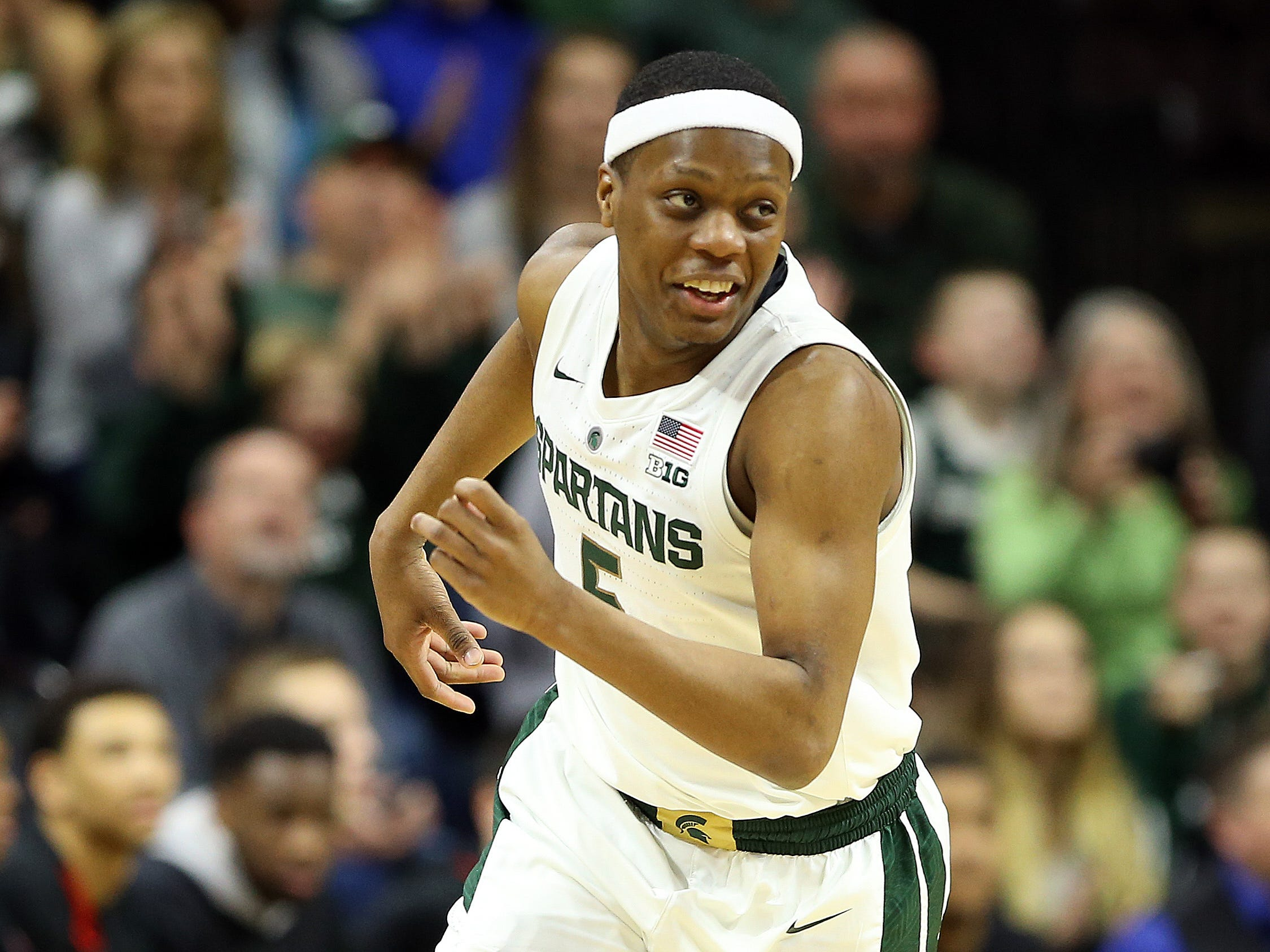 Michigan State Spartans guard Cassius Winston (5) reacts during the first half of a game against the Northern Illinois Huskies at the Breslin Center.