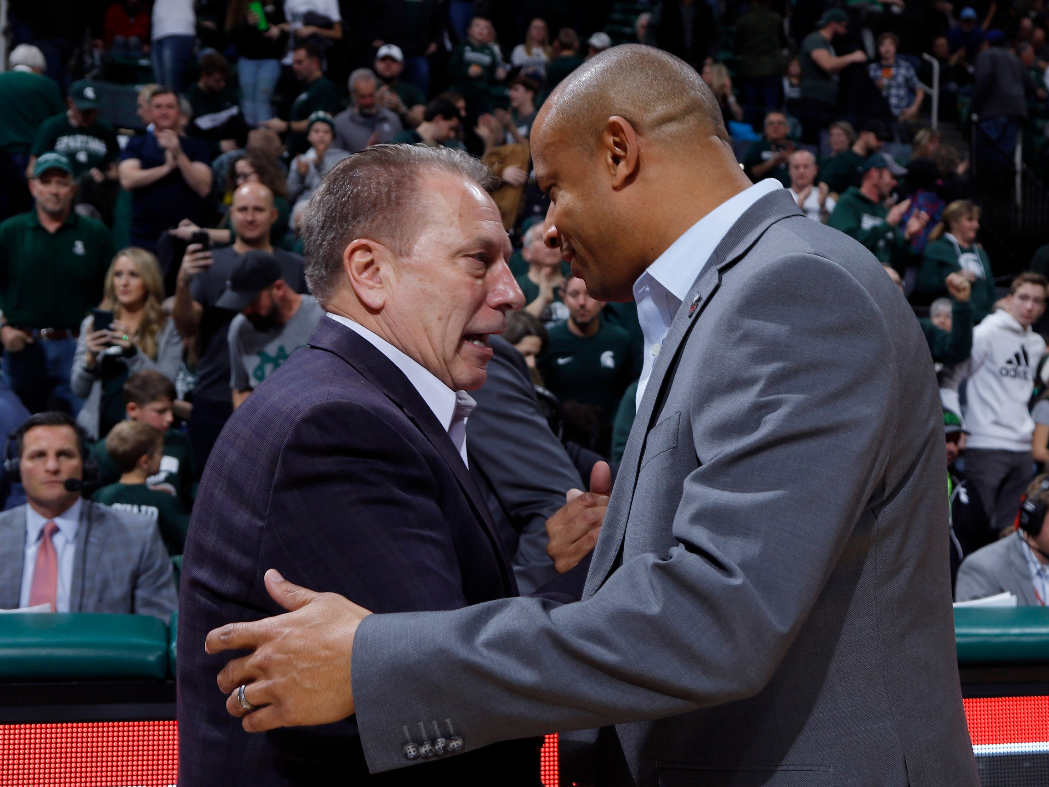 Michigan State coach Tom Izzo, left, and Northern Illinois coach Mark Montgomery, a former Izzo assistant shake hands following their game, Saturday, Dec. 29, 2018, in East Lansing, Mich.