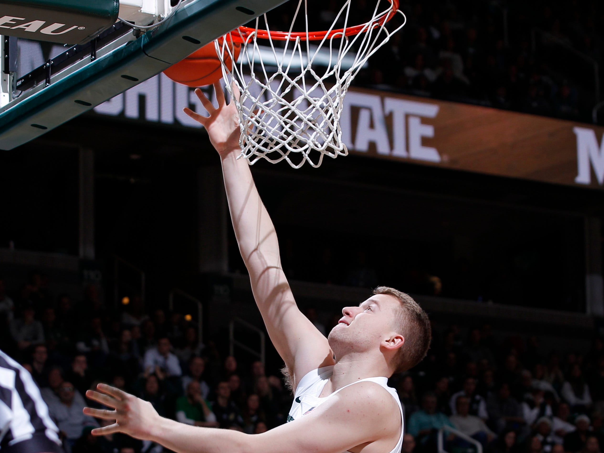 Michigan State's Thomas Kithier puts up a layup against Northern Illinois' Dante Thorpe, Saturday, Dec. 29, 2018, in East Lansing, Mich.