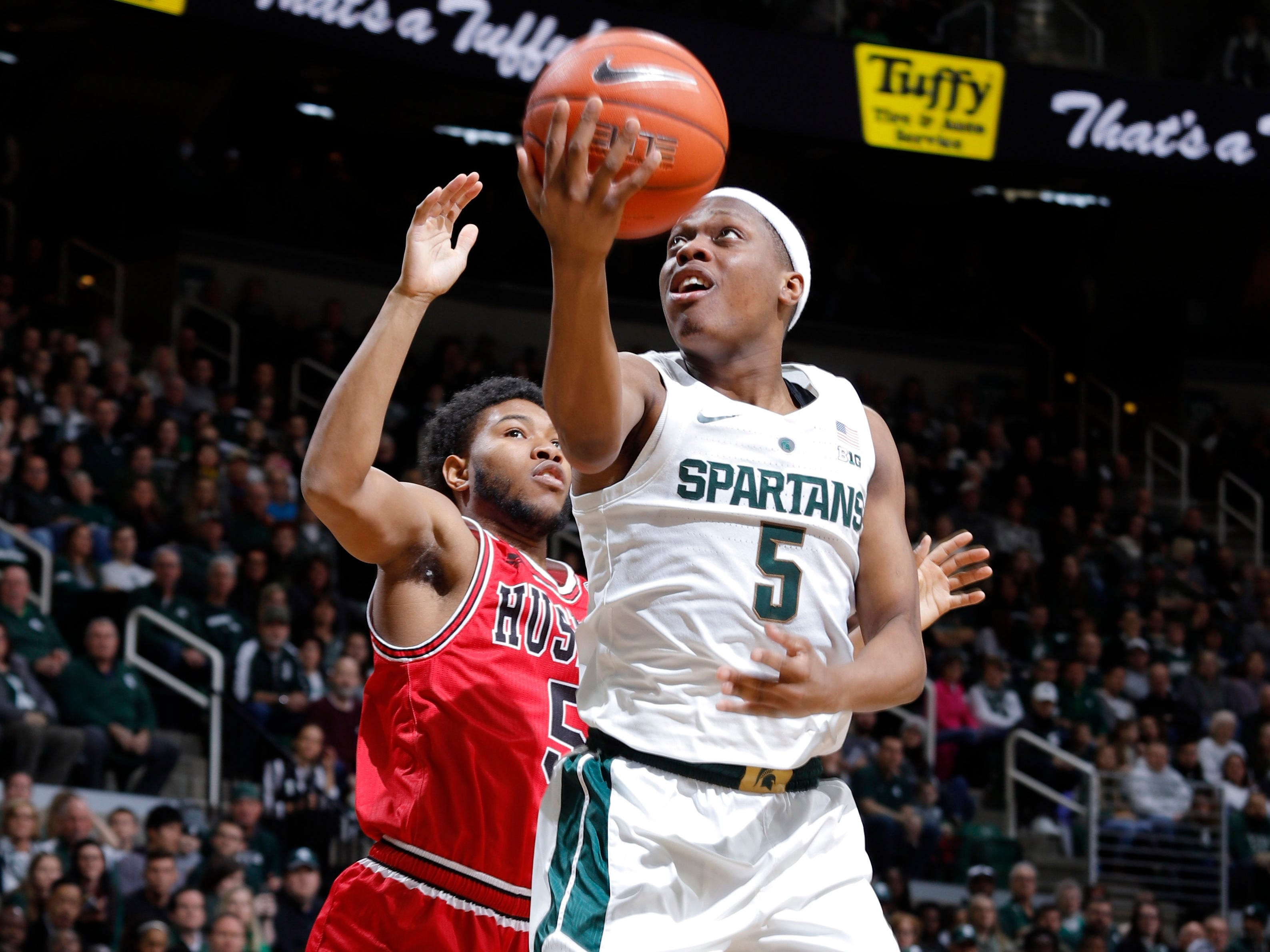 Michigan State's Cassius Winston goes up for a layup against Northern Illinois' Zaire Mateen, Saturday, Dec. 29, 2018, in East Lansing, Mich.
