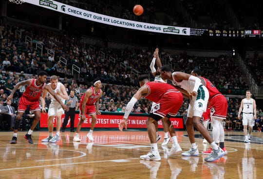 With all freshmen on the floor, Michigan State's Thomas Kithier, left, Foster Loyer, right, and Marcus Bingham Jr., watch as Aaron Henry shoots a free throw against Northern Illinois, Saturday, Dec. 29, 2018, in East Lansing, Mich.