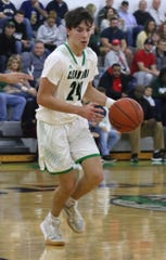 Clear Fork's Brennan South dribbles the ball down the court while playing against Madison earlier in the season.