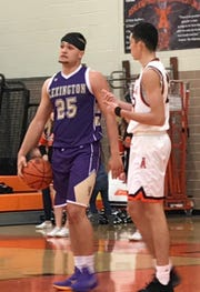 Lexington's Cade Stover went to a headband to help contain the bleeding after he and teammate Ben Vore bumped heads in Friday's Ohio Cardinal Conference basketball game at Ashland.