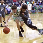 Clear Fork's AJ Blubaugh fights off a Madison defender while trying to gain control of the basketball in a game this season.