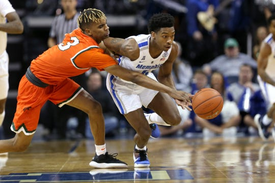 Memphis Tigers guard Kareem Brewton Jr. steals the ball from Florida A&M Rattlers guard MJ Randolph during their game at the FedExForum on Saturday, Dec. 29, 2018.