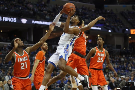 Memphis Tigers guard Jeremiah Martin makes a put back shot over Florida A&M Rattlers guard Justin Ravenel during their game at the FedExForum on Saturday, Dec. 29, 2018.
