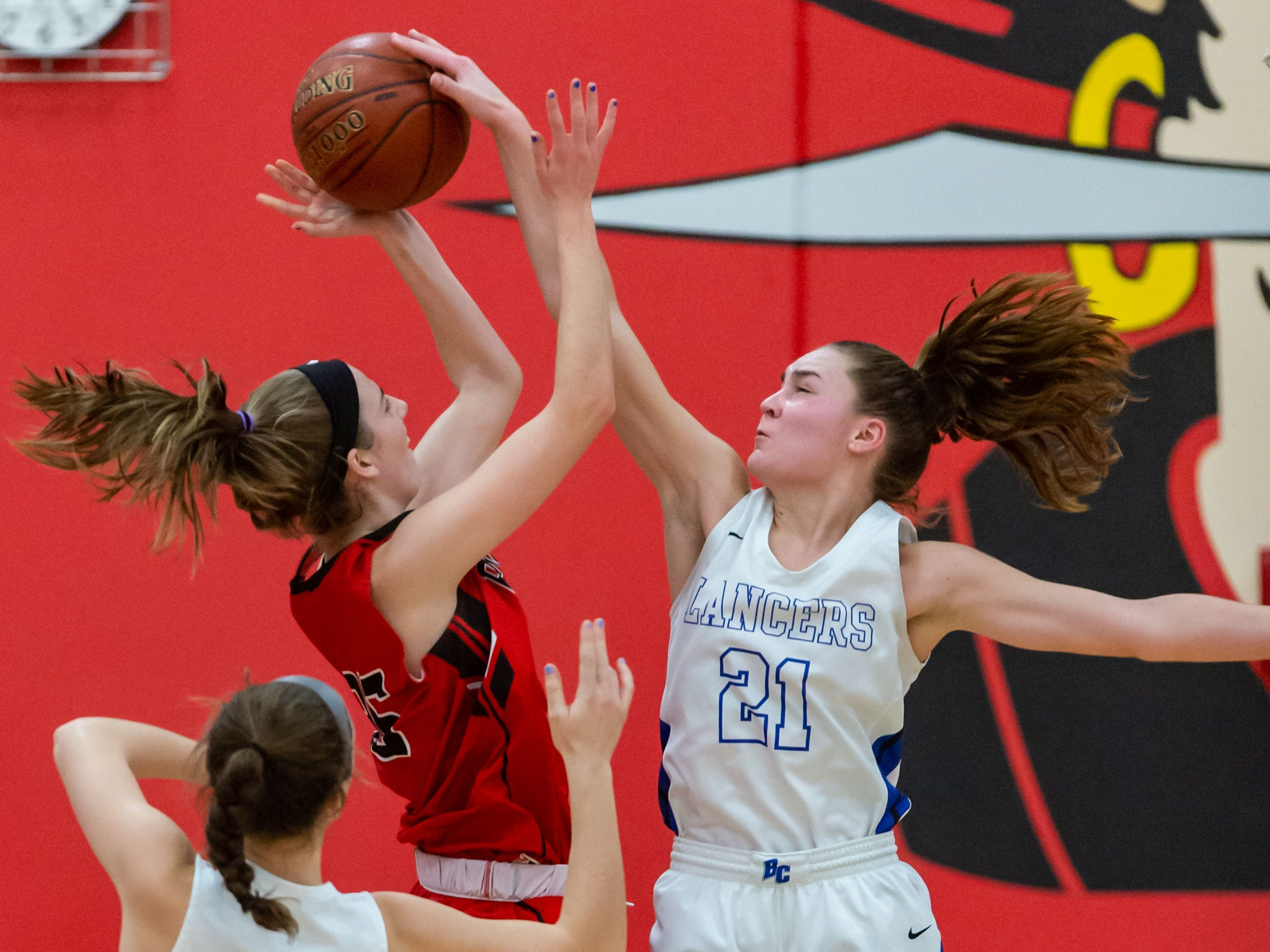 Brookfield Central's Anna Mortag (21) rejects a shot by Pewaukee's Vivianne Jende (35) during the game at Pewaukee on Friday, Dec. 28, 2018.