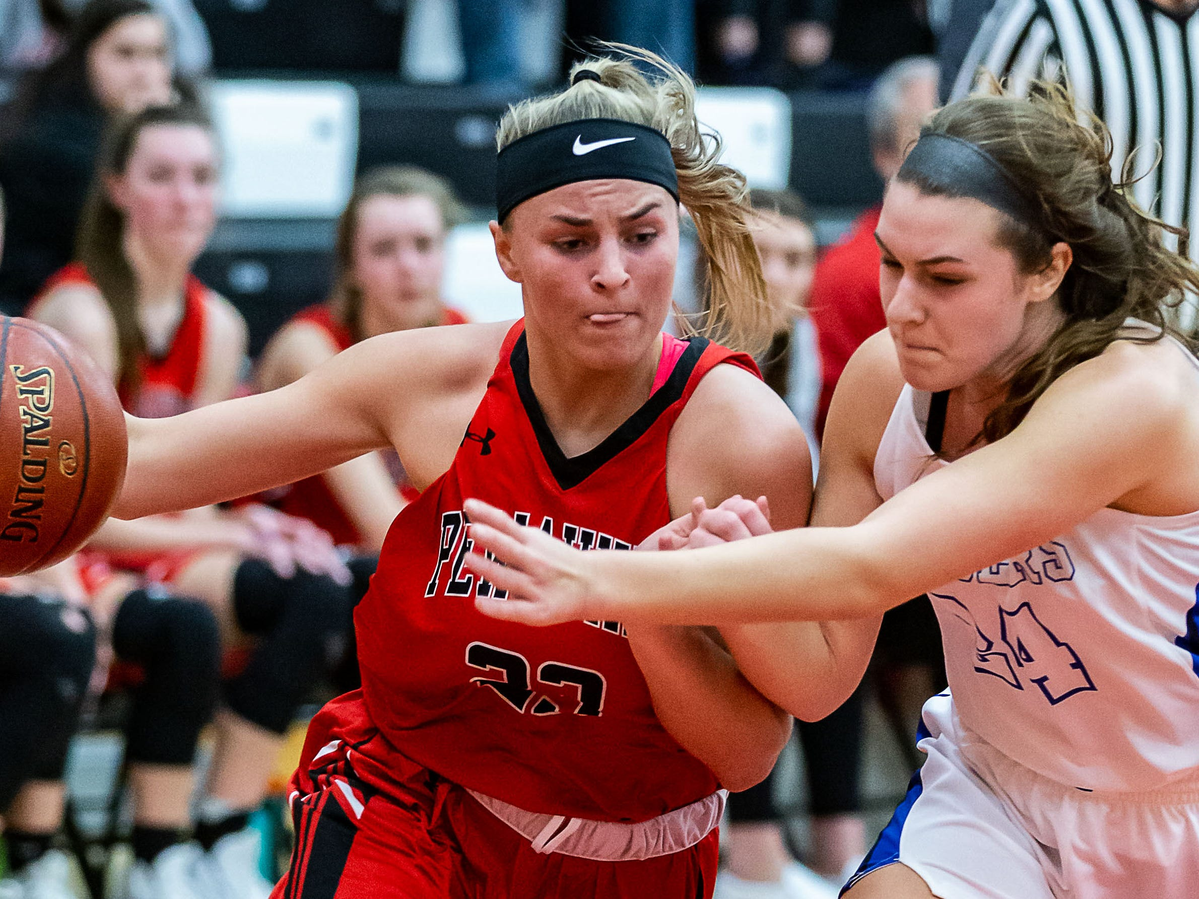Pewaukee's Lauren Schill (left) battles to get past Brookfield Central's Grace Rudek (24) during the game at Pewaukee on Friday, Dec. 28, 2018.