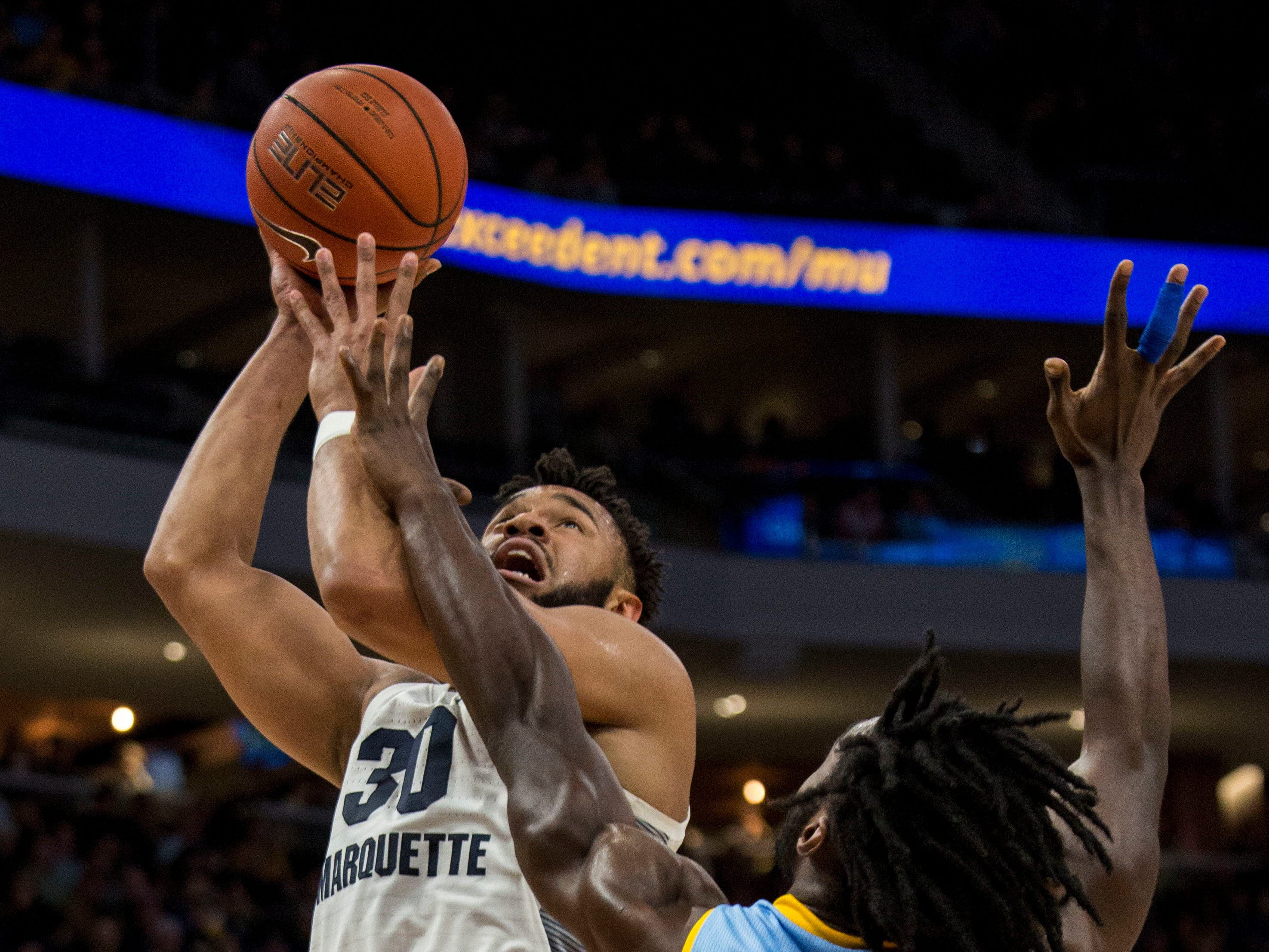 Marquette forward Ed Morrow goes up for a shot against Southern forward Bryan Assie on Friday night.