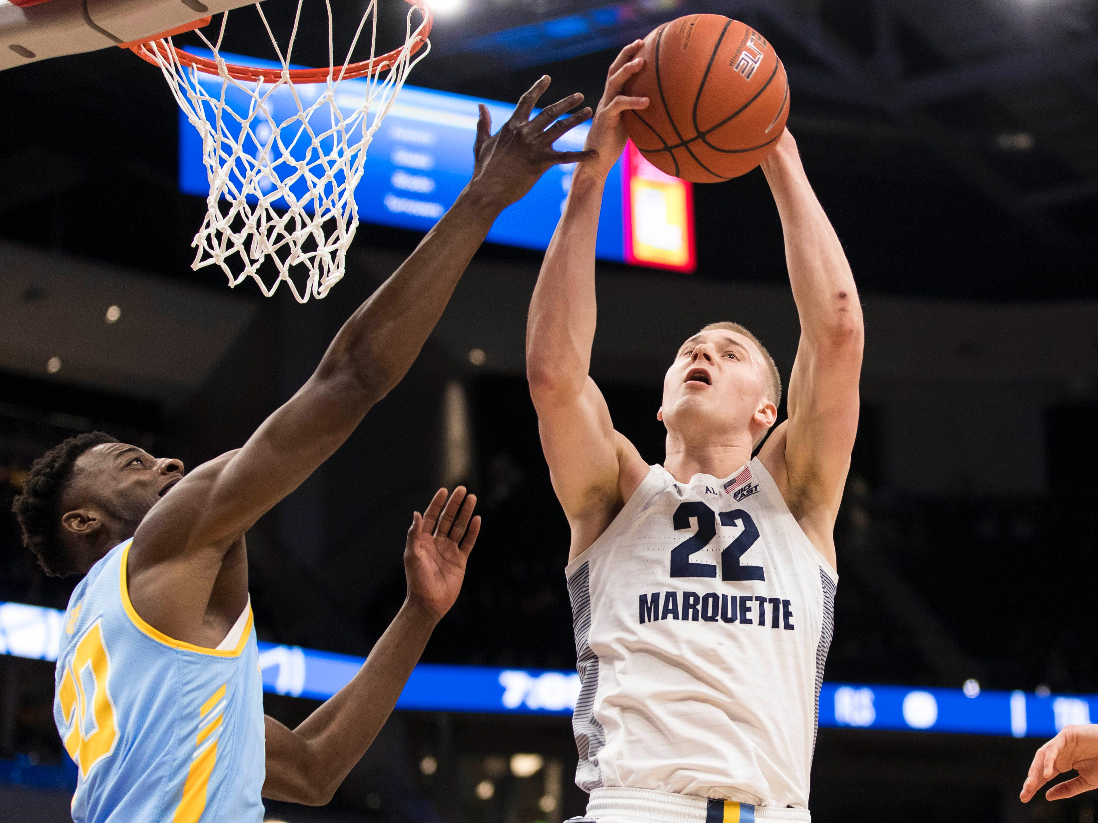 Marquette forward Joey Hauser grabs one of his nine rebounds on the night against Southern on Friday.