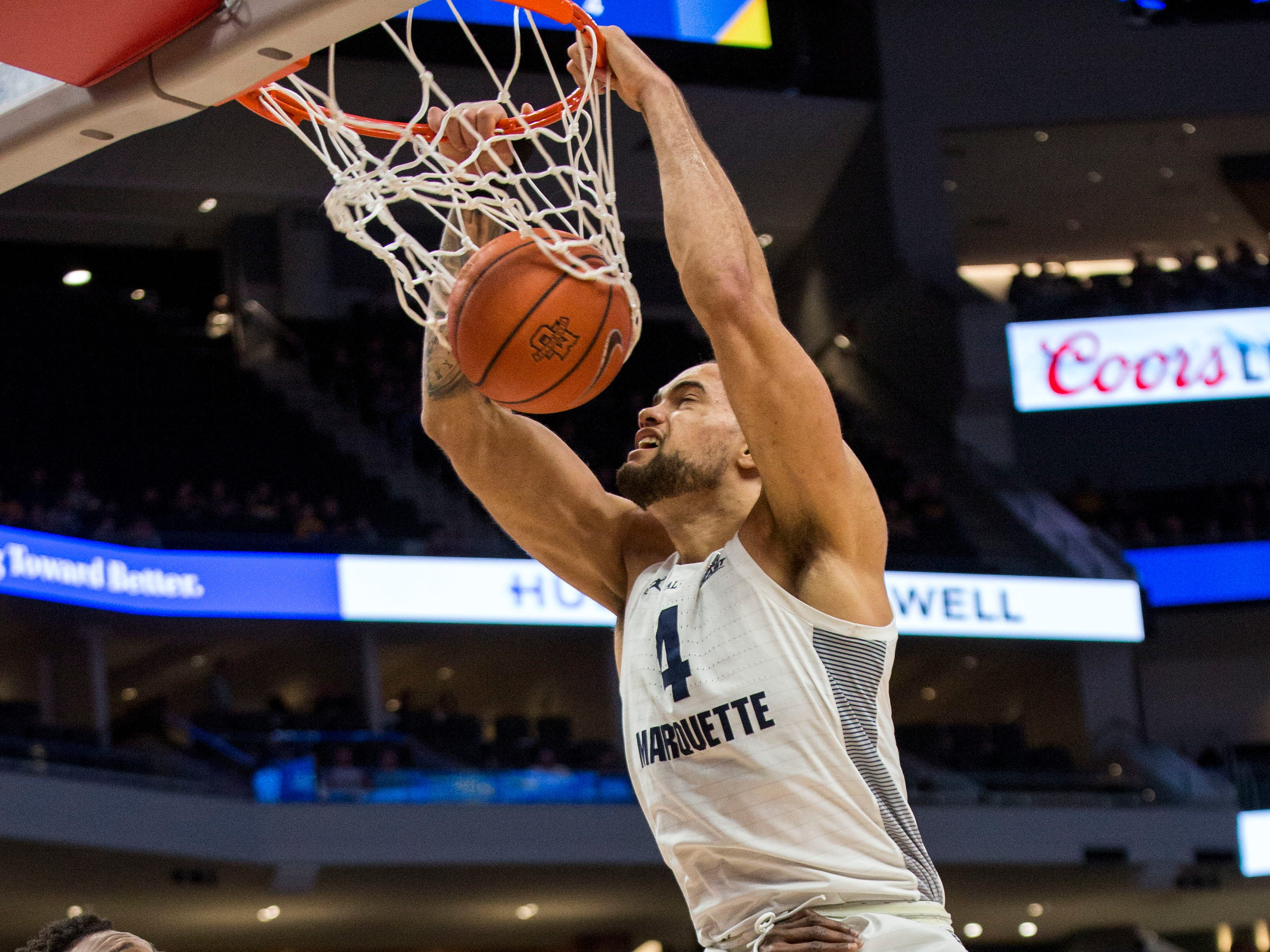 Marquette forward Theo John slams home two points against Southern on Friday night.