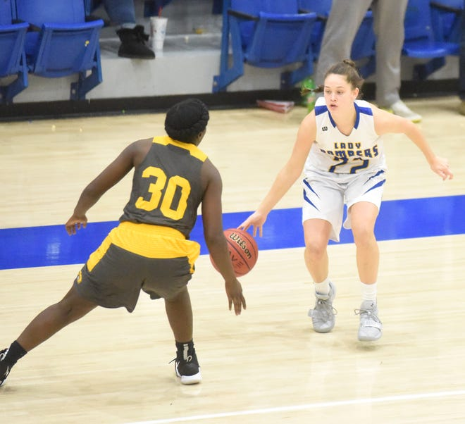 Mountain Home's Kate Gilbert is pressured by Watson Chapel's Whittaker Moorehead on Friday night.