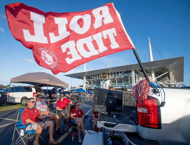 Alabama fans tailgate before the Orange Bowl at Hard Rock Stadium in Miami Gardens, Fla., on Saturday December 29, 2018.