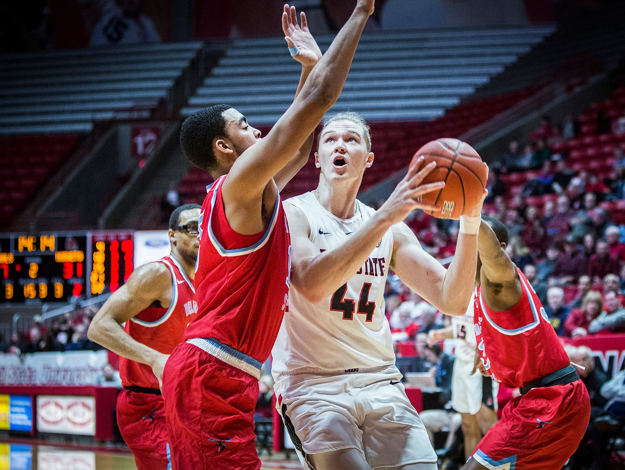 Ball State's Blake Huggins looks for an opening in Delaware State's defense during their game at Worthen Arena Saturday, Dec. 29, 2018.