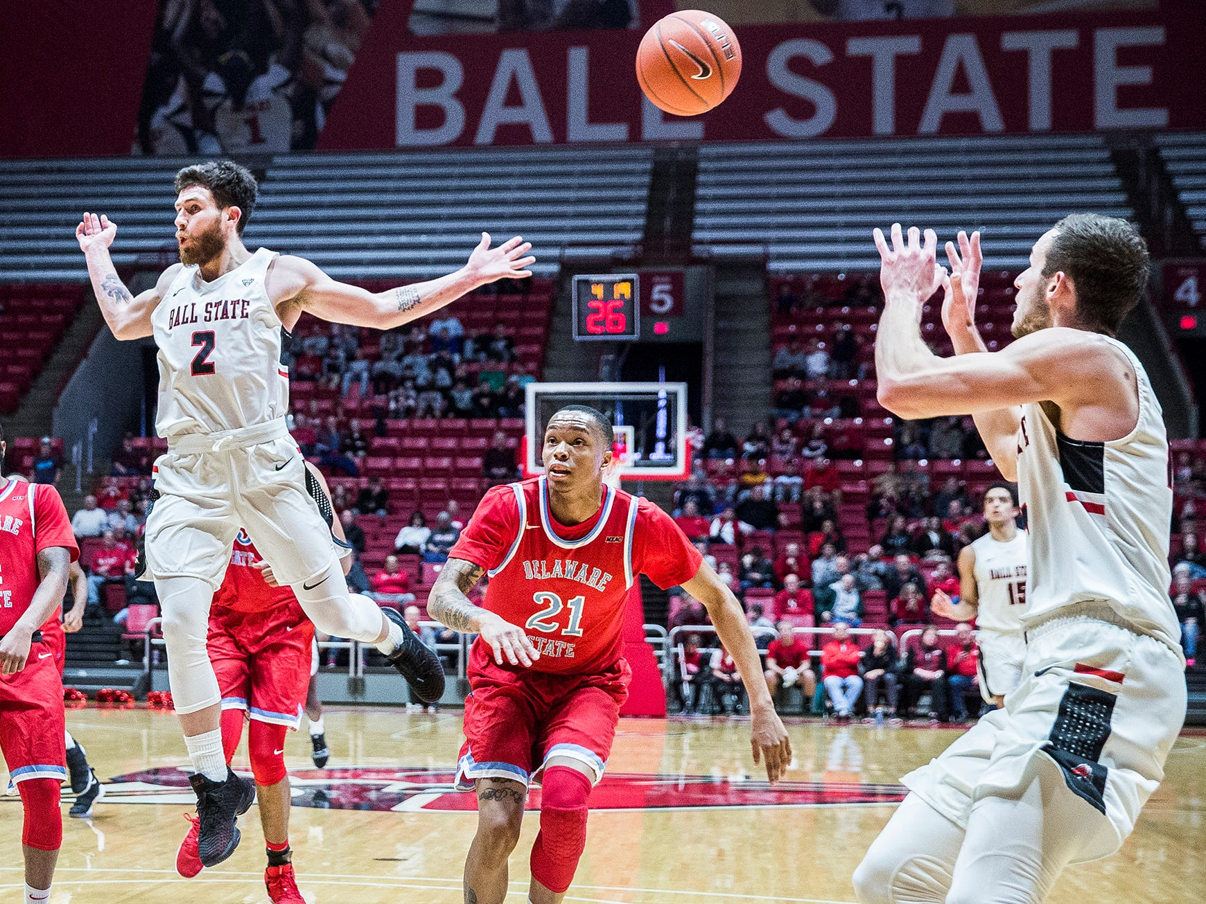 Ball State's Tayler Persons passes  past Delaware State's defense during their game at Worthen Arena Saturday, Dec. 29, 2018.