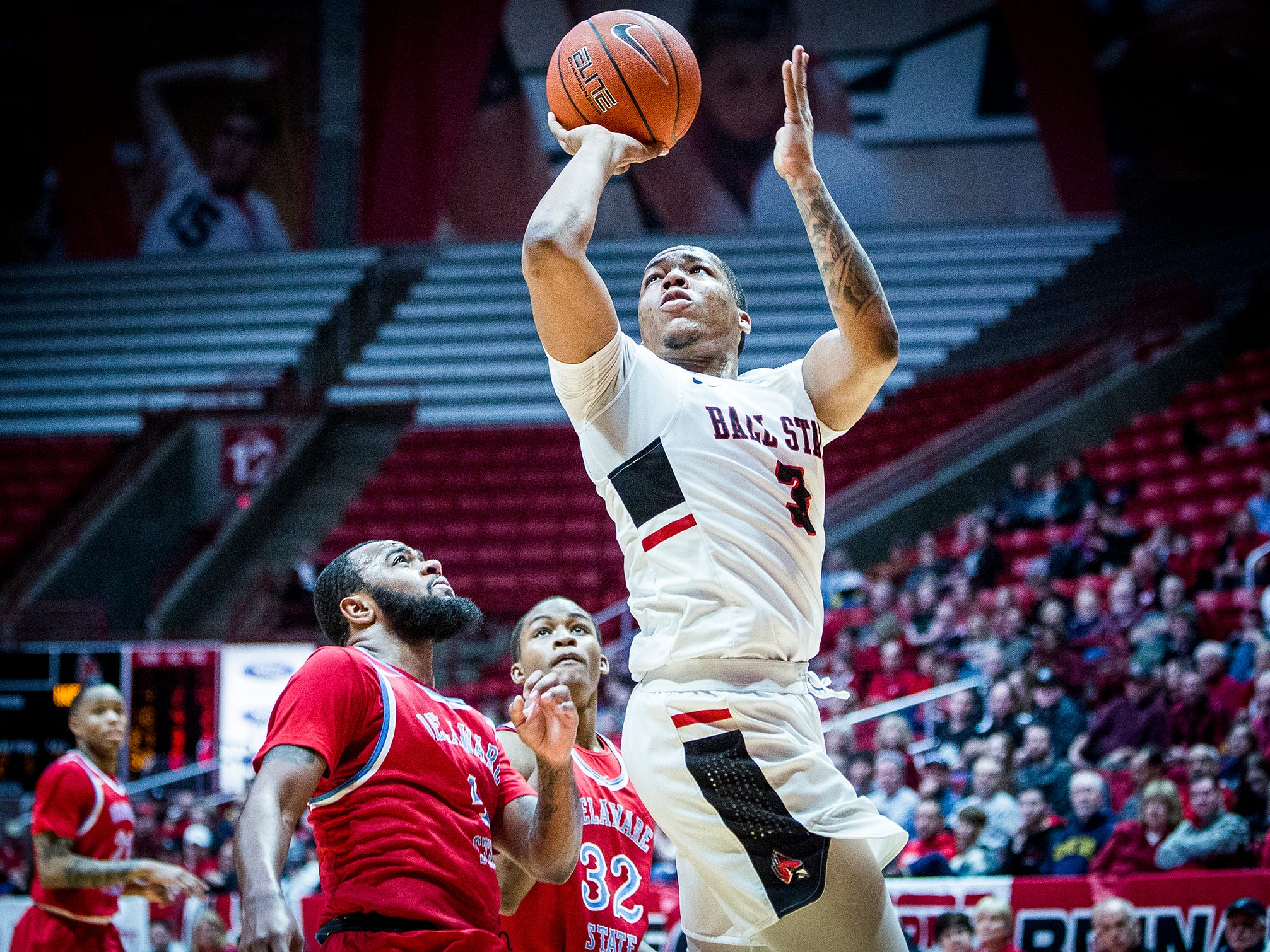 Ball State's Josh Thompson shoots past Delaware State's defense during their game at Worthen Arena Saturday, Dec. 29, 2018.