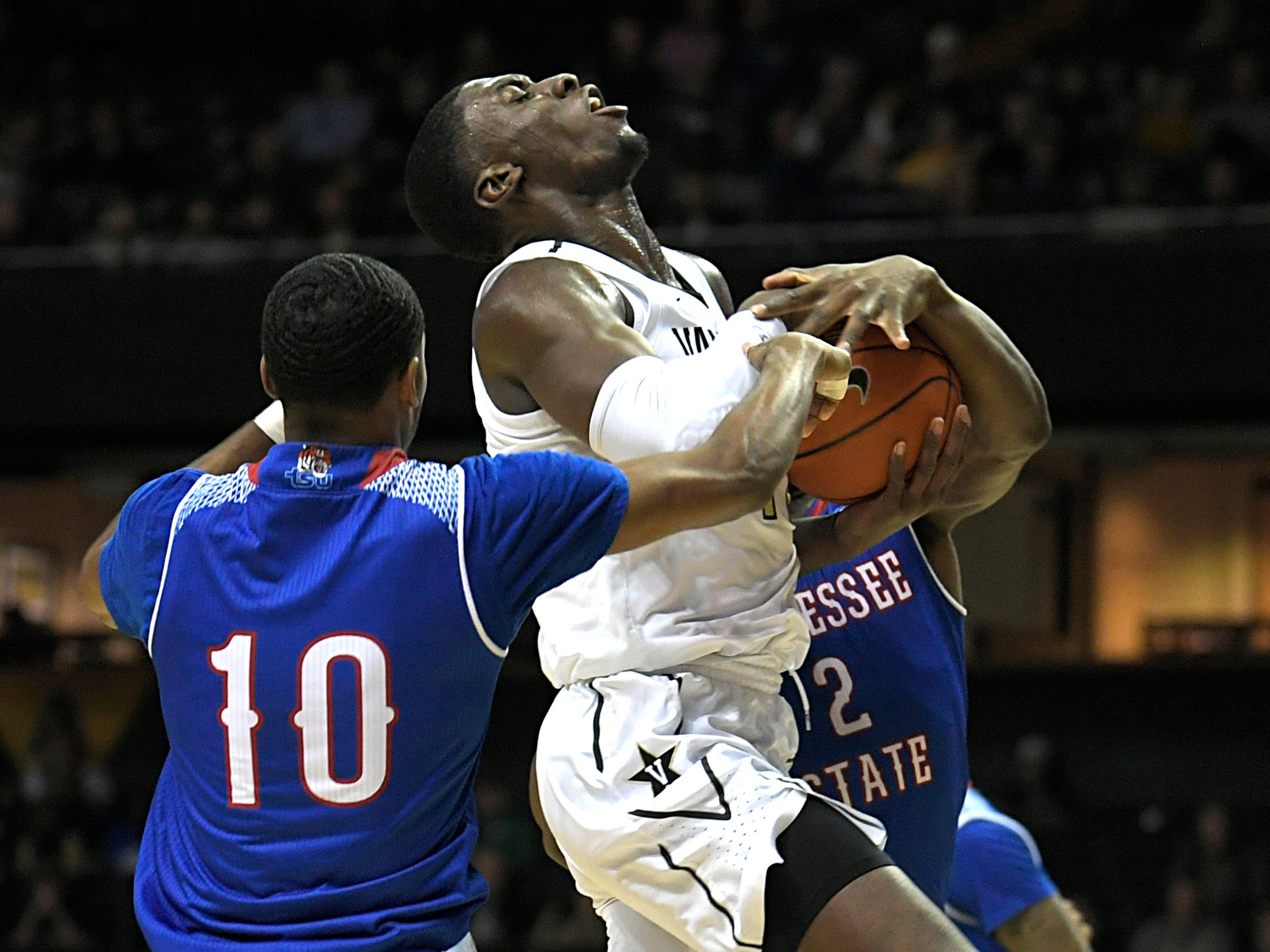 Vanderbilt forward Simisola Shittu (11) drives to the basket against TSU players during a game at Memorial Gym in Nashville on Saturday, Dec. 29, 2018.