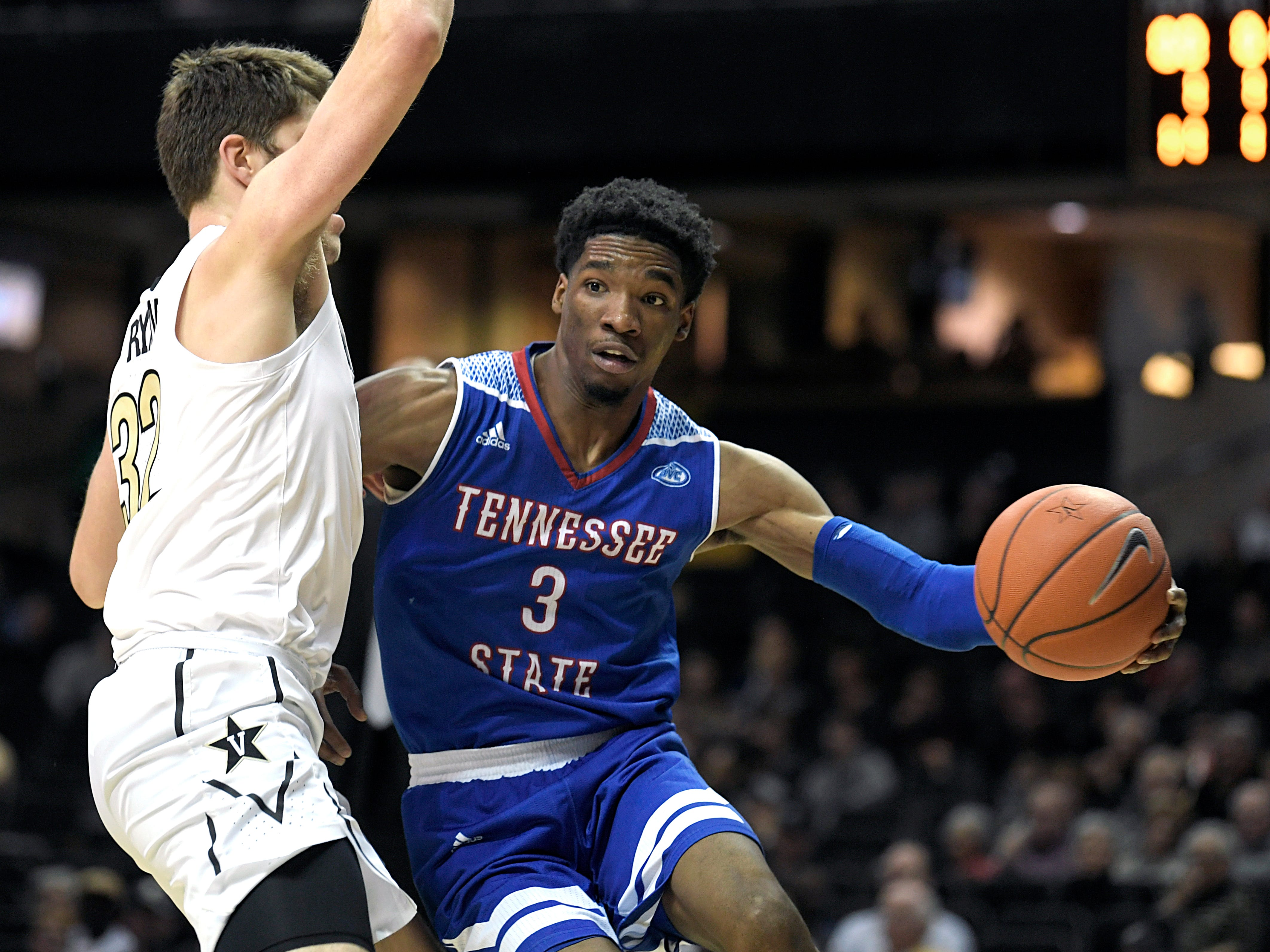 Tennessee State guard Donte Fitzpatrick-Dorsey (3) drives to the basket against Vanderbilt forward Matt Ryan (32) during a game at Memorial Gym in Nashville on Saturday, Dec. 29, 2018.