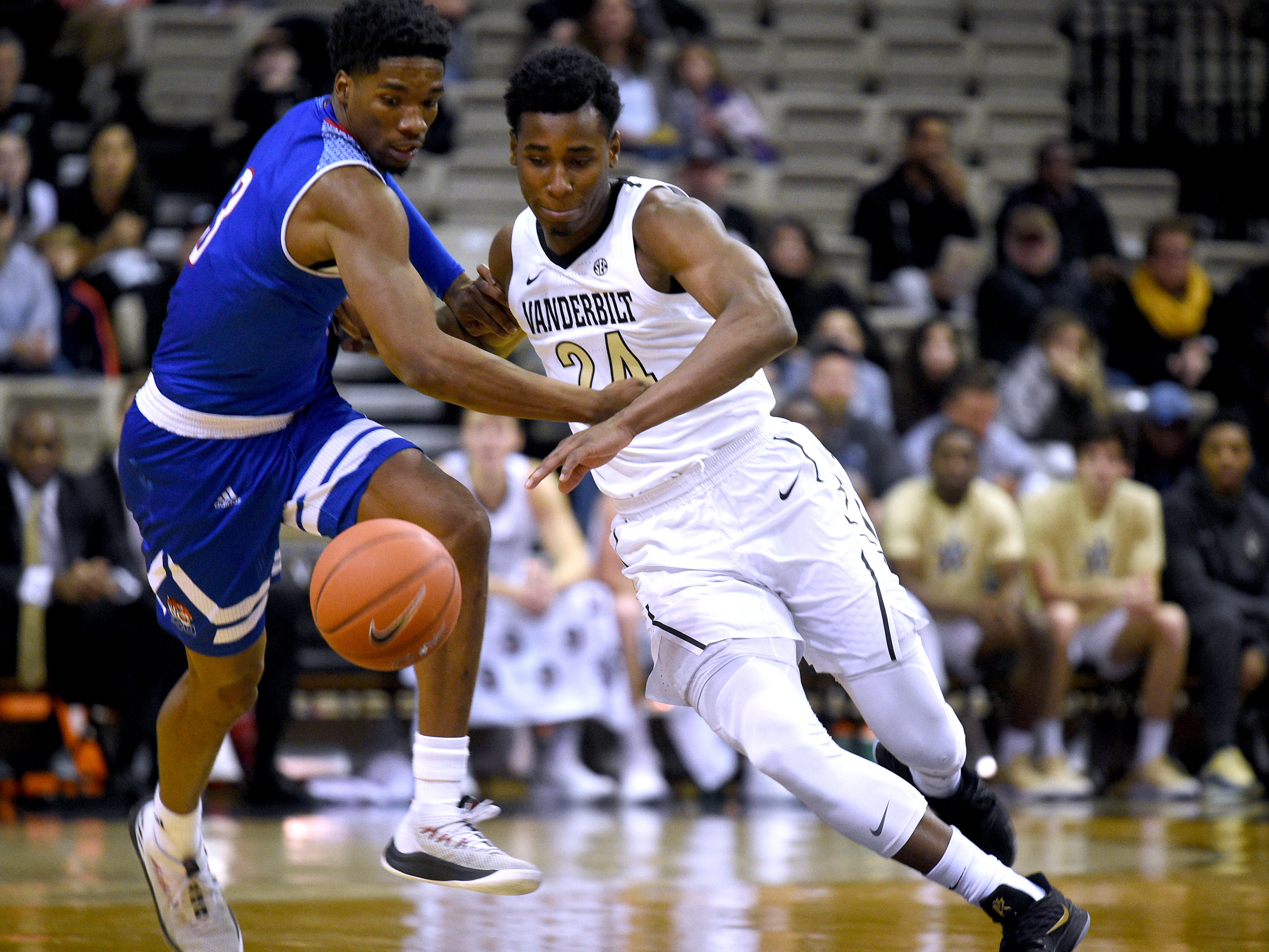 Vanderbilt forward Aaron Nesmith (24) and Tennessee State guard Donte Fitzpatrick-Dorsey (3) fight for control of the ball during a game at Memorial Gym in Nashville on Saturday, Dec. 29, 2018.