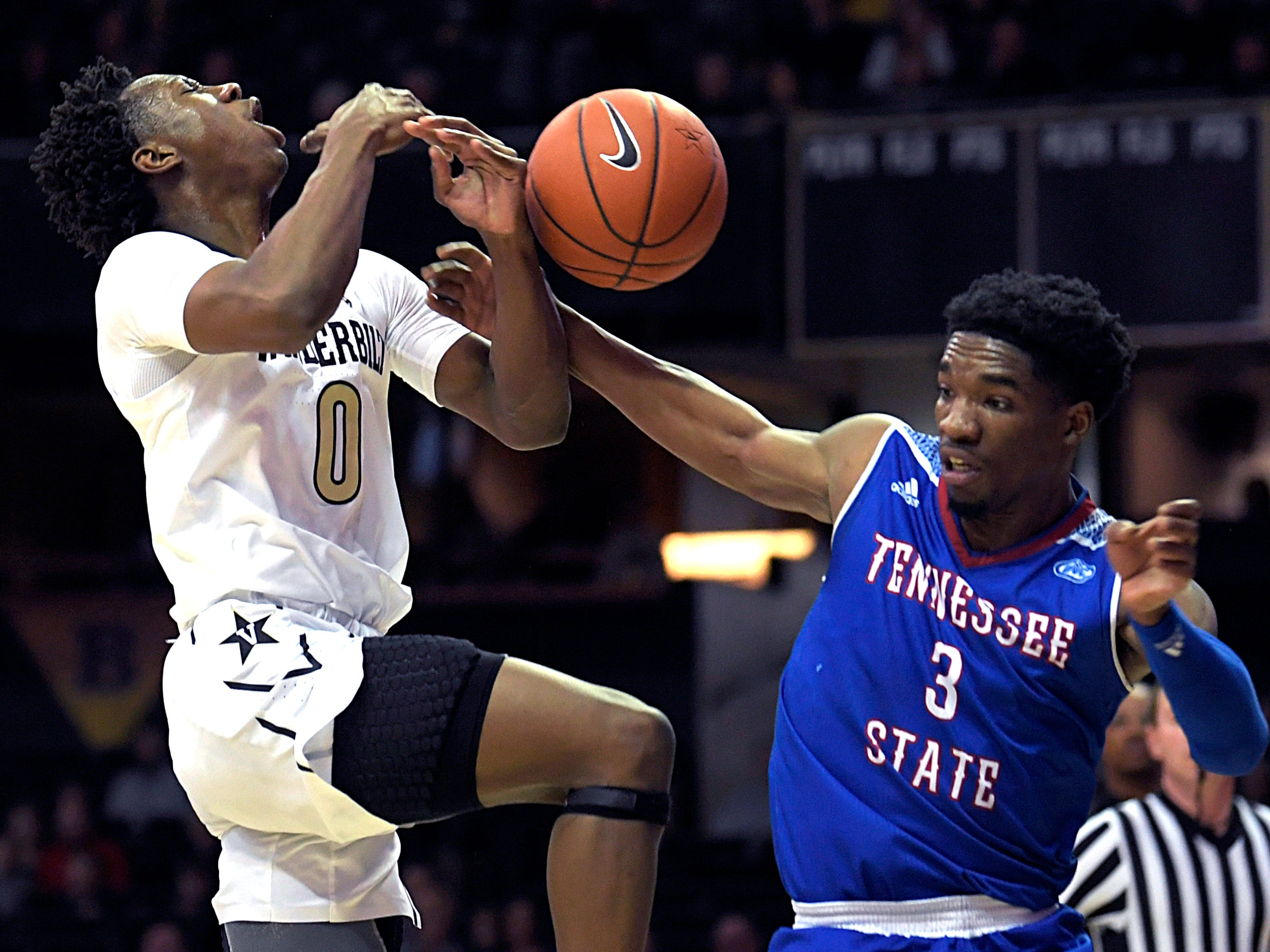 Vanderbilt guard Saben Lee (0) is fouled by Tennessee State guard Donte Fitzpatrick-Dorsey (3) as he drives to the basket during a game at Memorial Gym in Nashville on Saturday, Dec. 29, 2018.