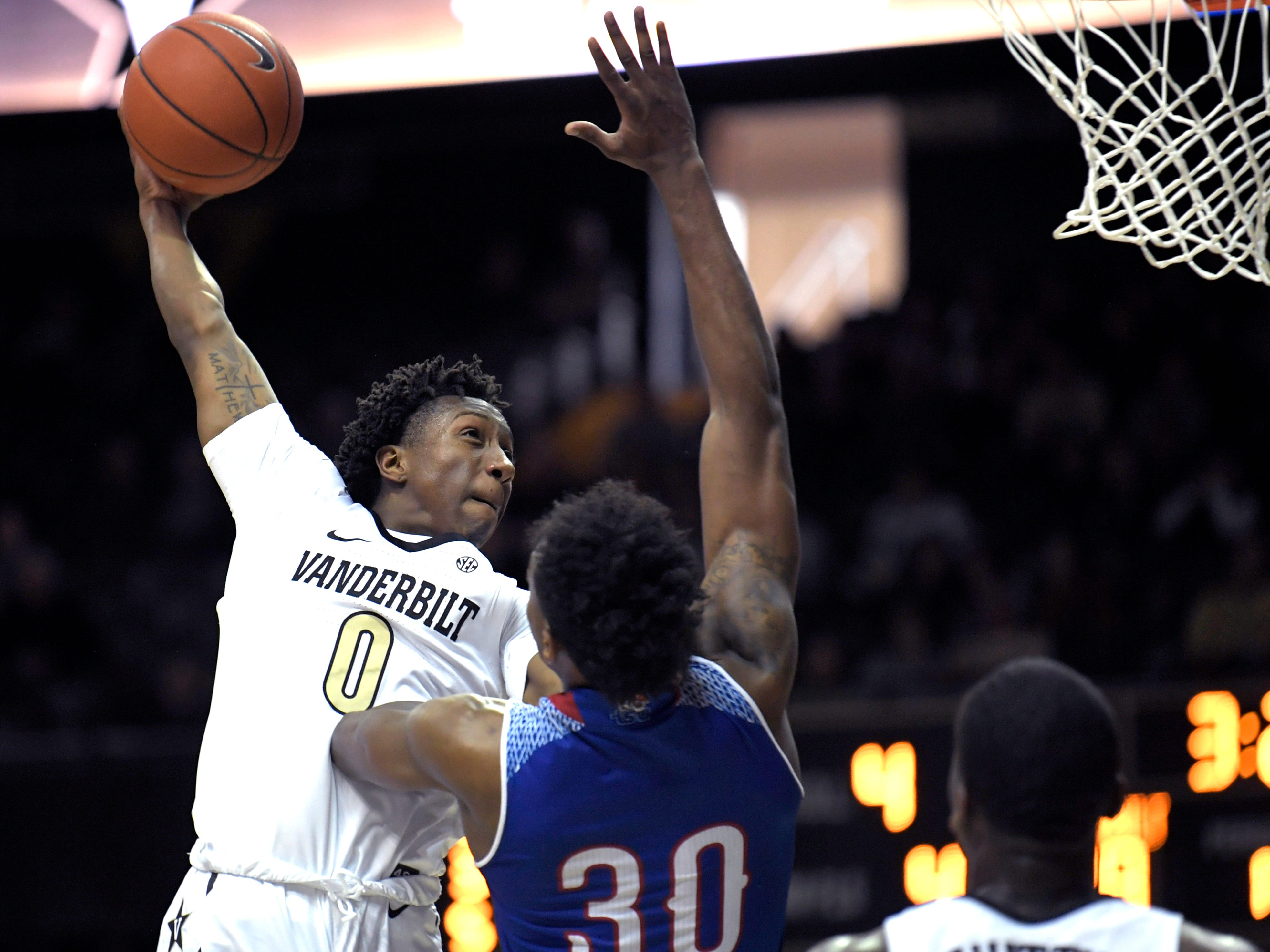 Vanderbilt guard Saben Lee (0) dunks the ball over Tennessee State forward Stokley Chaffee Jr. (30) during a at Memorial Gym in Nashville on Saturday, Dec. 29, 2018.