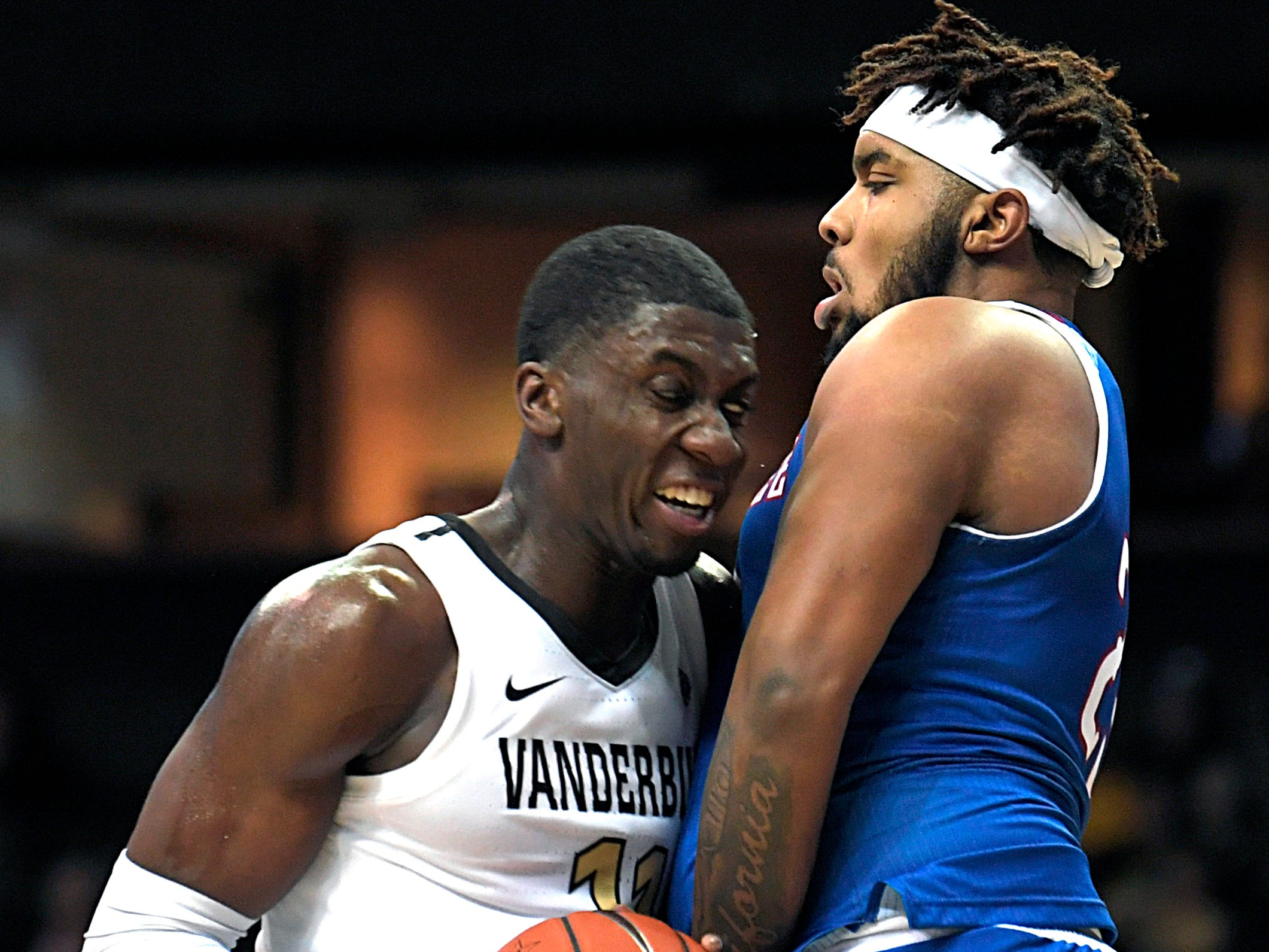 Vanderbilt forward Simisola Shittu (11) drives to the basket and is stopped by Tennessee State forward DaJion Henderson (23) during a game at Memorial Gym in Nashville on Saturday, Dec. 29, 2018.