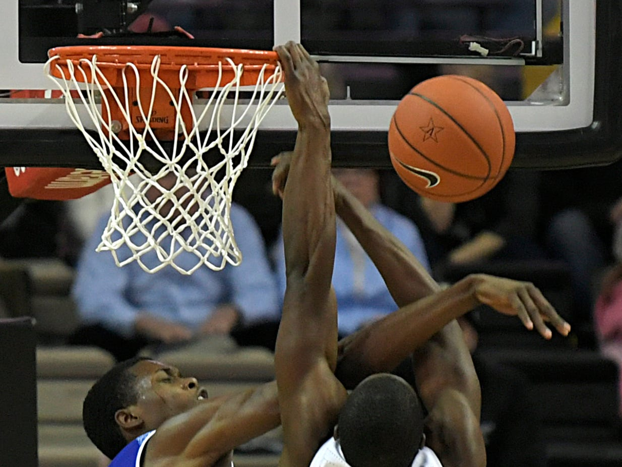 Vanderbilt guard Maxwell Evans (3) is fouls by Tennessee State forward Damarri Moore (4) during a game at Memorial Gym in Nashville on Saturday, Dec. 29, 2018.