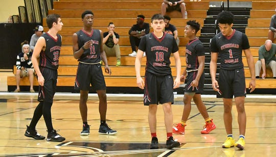 Stoneman Douglas High School basketball players take the floor after a timeout during their game with Golden Gate High School in the Kelleher Firm Gulfshore Holiday Hoopfest on Thursday.