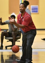 Stoneman Douglas High School head basketball coach Orlando McCorvey during their game with Golden Gate High School in the Kelleher Firm Gulfshore Holiday Hoopfest on Thursday.