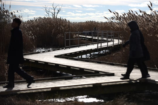 Strollers took advantage of a seasonably warm Saturday to walk along the boardwalk at DeKorte Park in Lyndhurst on Dec. 29. The park remains open from 8 a.m. to dusk through the winter months.