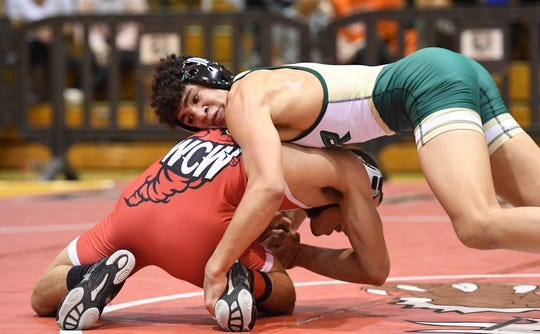 Bergen County wrestling finals at Hackensack High School on Friday, December 28, 2018. Sammy Alvarez (St. Joseph) on his way to defeating Trent Furman (Westwood) in their 132 pound match.